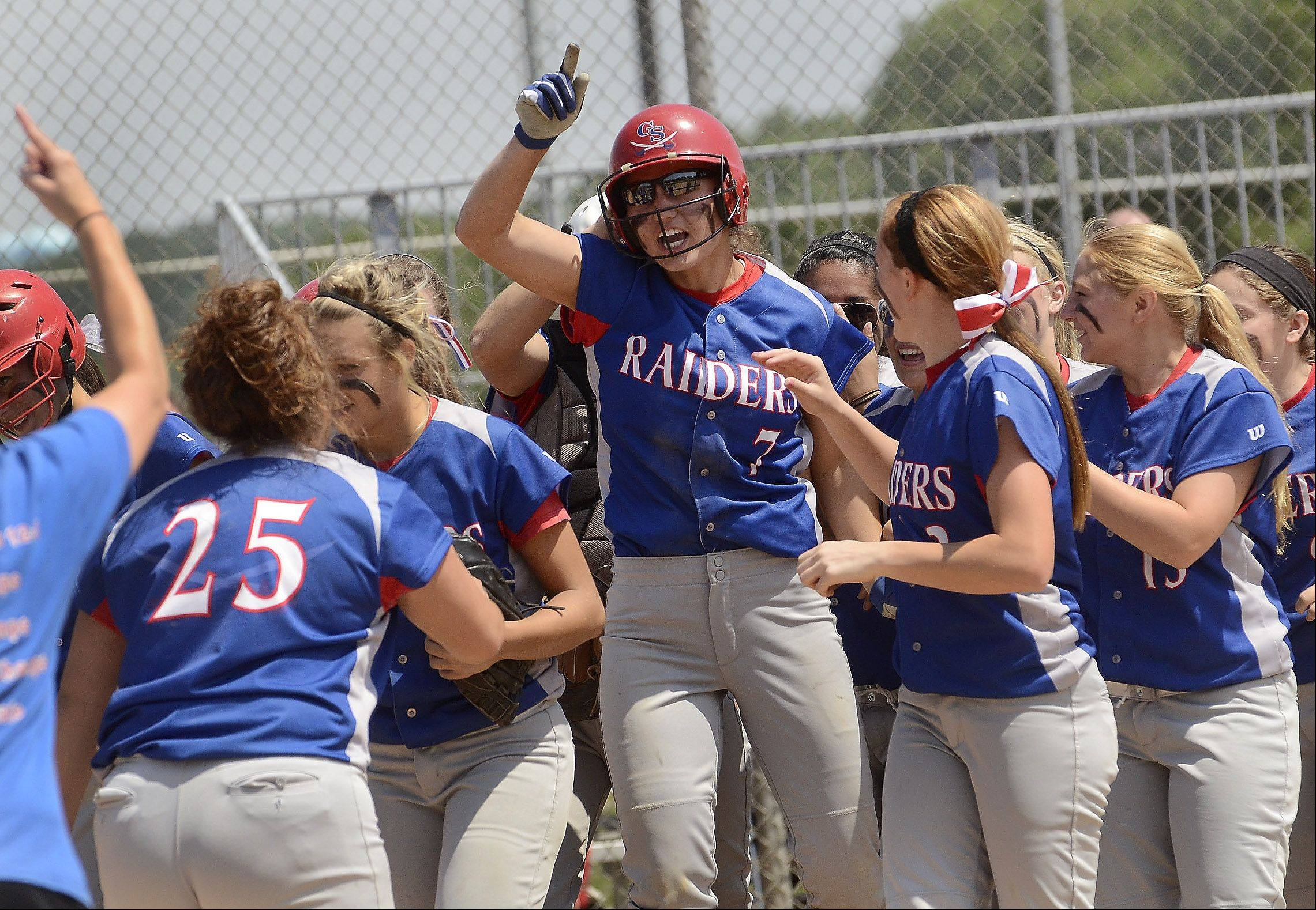 Glenbard South's Hannah Taylor celebrates with her teammates after hitting a two-run home run in the 4th inning of the Class 3A state semifinal between Glenbard South and Tinley Park.