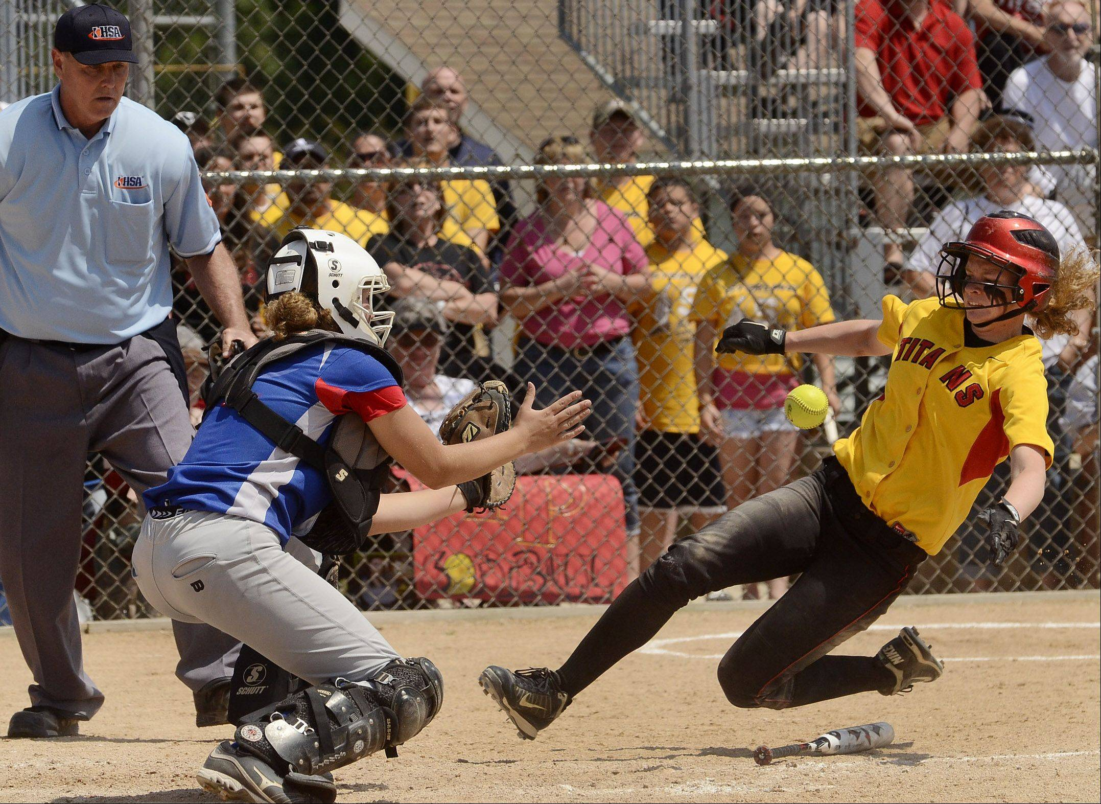 Glenbard South's catcher Jane Trzaska tags out Tinley Park's Samantha Alberto in the 6th inning of the Class 3A state semifinal between Glenbard South and Tinley Park.