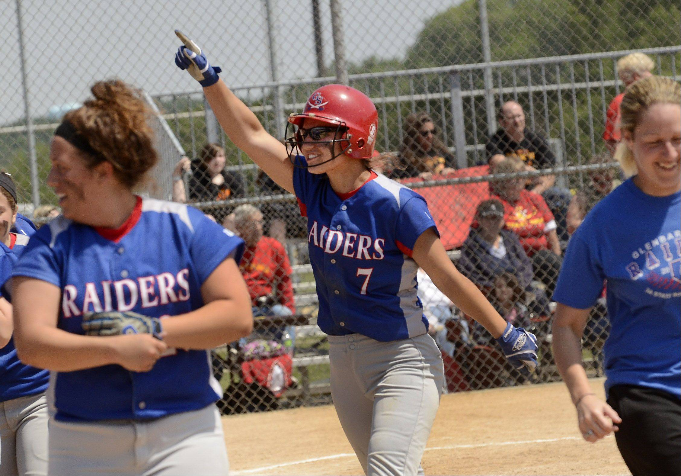 Glenbard South's Hannah Taylor points to the crowd while celebrating with her teammates after hitting a two-run home run in the 4th inning of the Class 3A state semifinal between Glenbard South and Tinley Park.