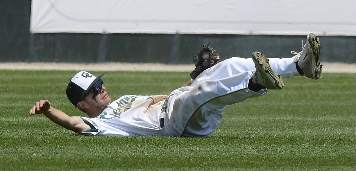 Grayslake Central center fielder Matt Loeffl rolls onto his back after making a diving catch in the sixth inning during the Class 3A state baseball semifinal against St. Francis at Silver Cross Field in Joliet Friday.