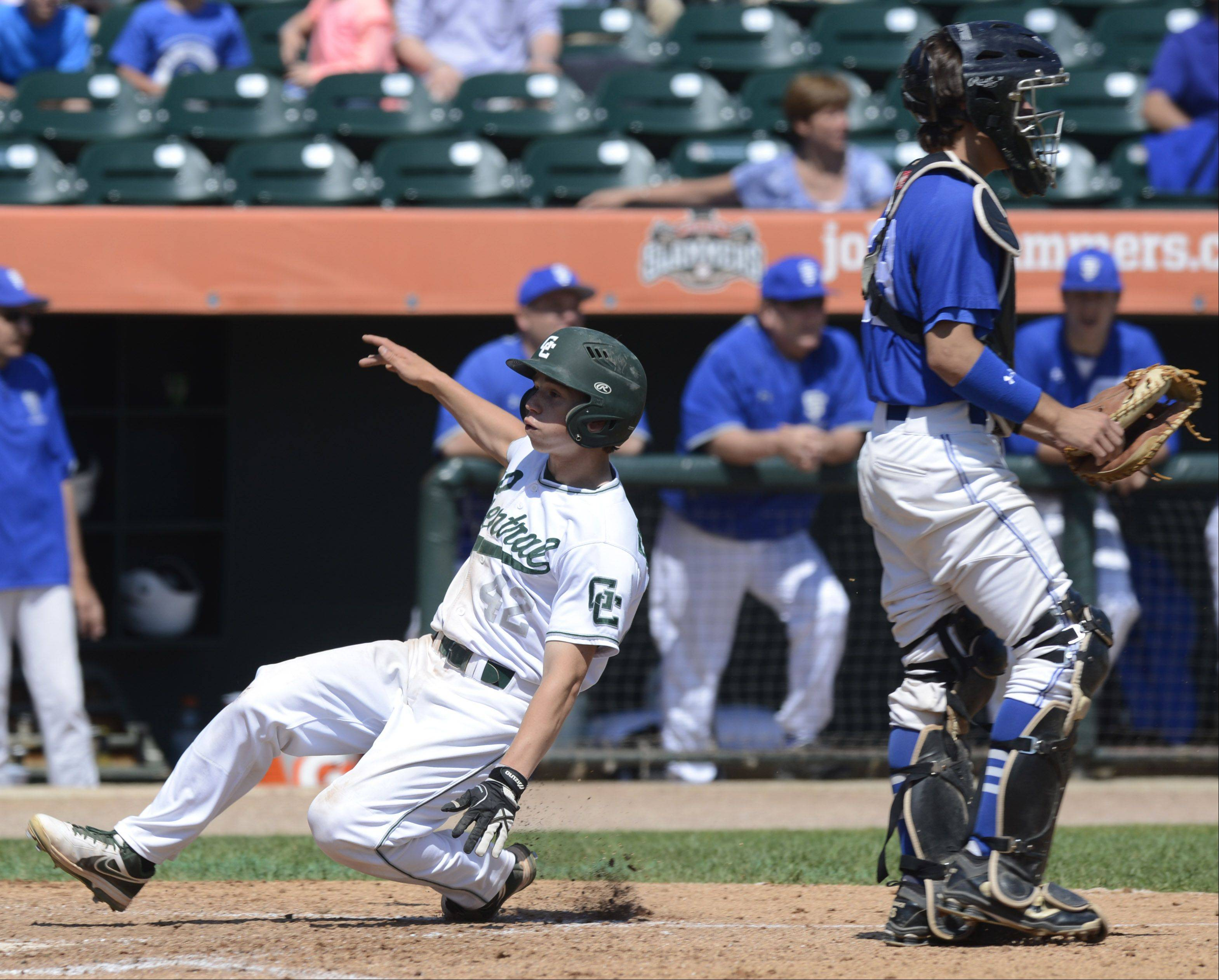 Grasylake Central's Ryan Fontana scores the Ram's first run of the game without a play by St. Francis catcher Brett Jungles during the Class 3A state baseball tournament at Silver Cross Field in Joliet Friday.