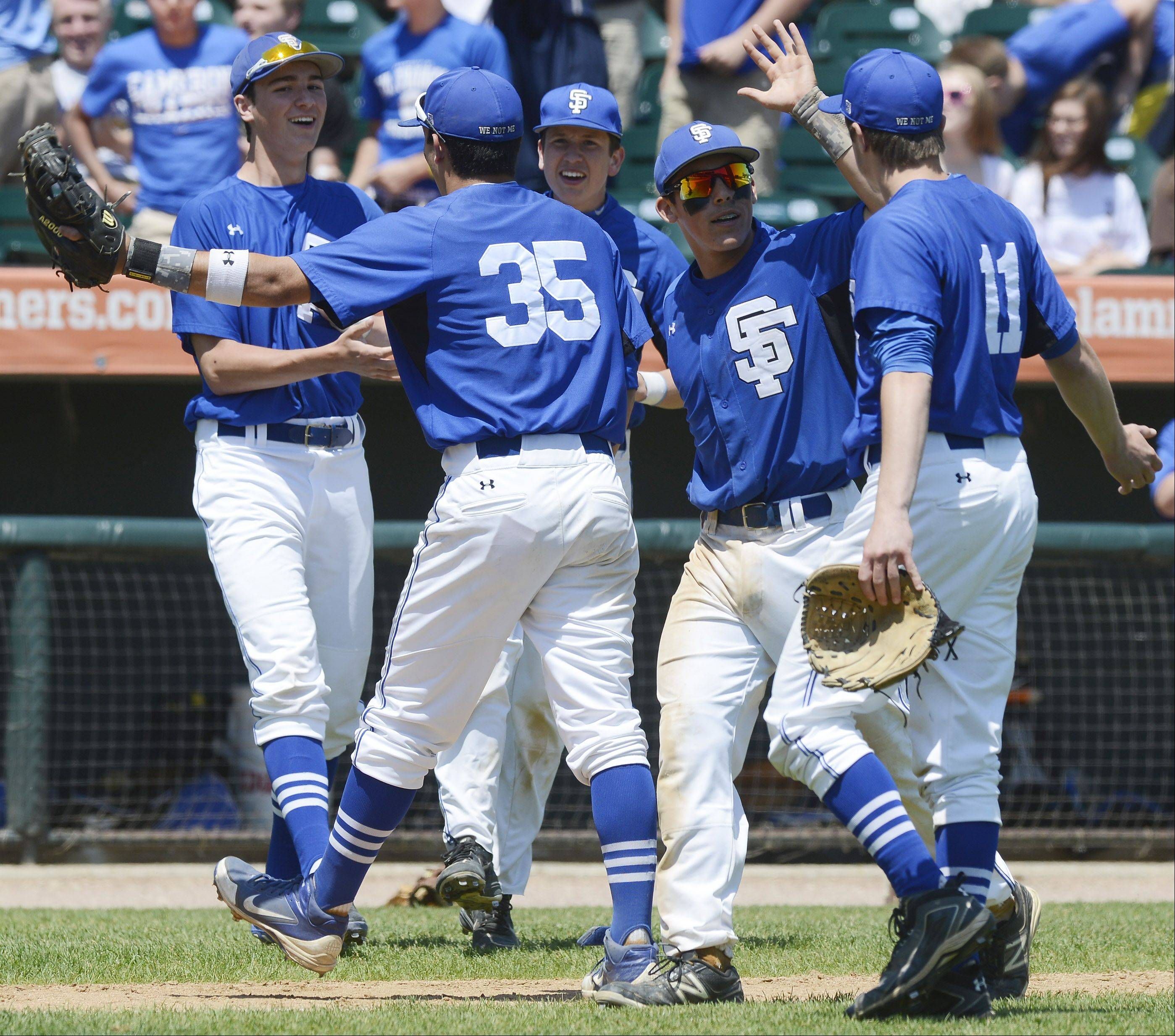 St. Francis players celebrate their victory over Grayslake Central during the Class 3A state baseball semifinal at Silver Cross Field in Joliet Friday.