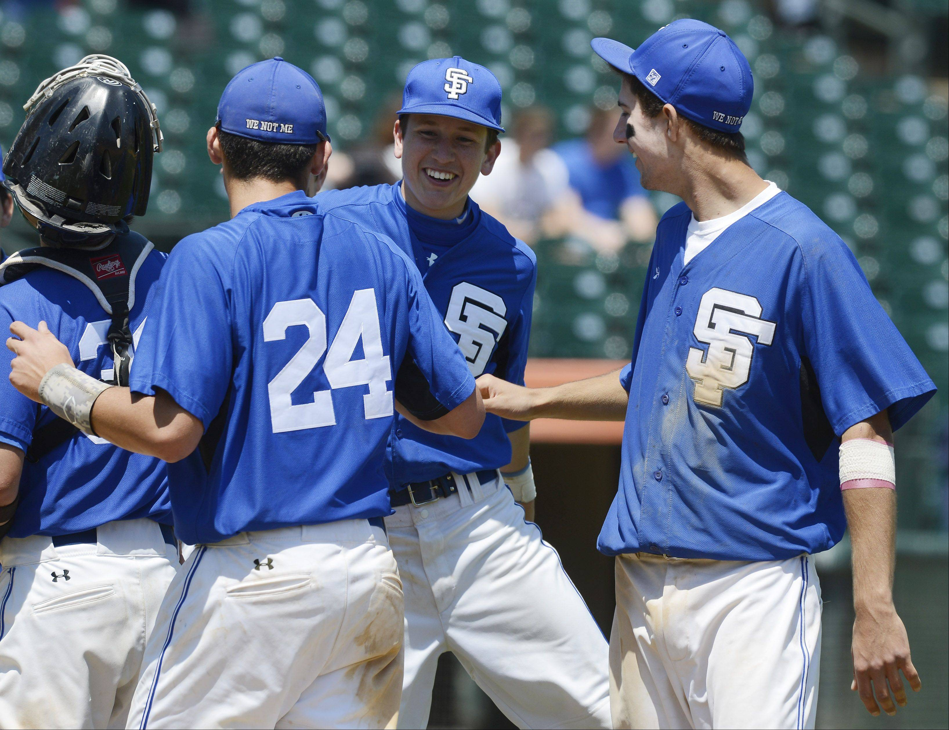 Left to right, St. Francis players Jason Sullivan, Jack Ciombor and Tim Zettinger celebrate their team's victory over Grayslake Central during the Class 3A state baseball semifinal at Silver Cross Field in Joliet Friday.