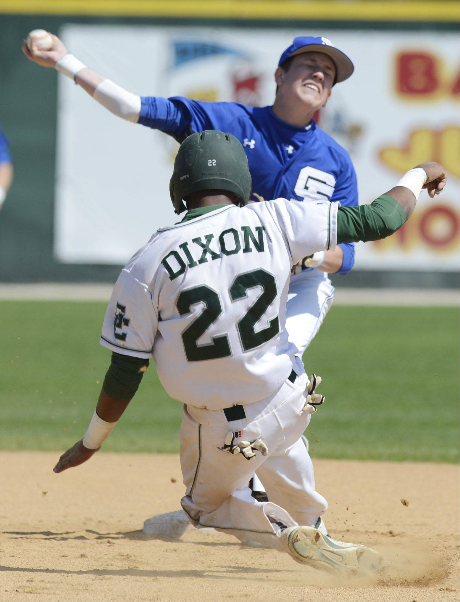 St. Francis second baseman Jack Ciombor makes the throw as Grayslake Central's Sterling Dixon slides into second on a second-inning double play during the Class 3A state baseball tournament at Silver Cross Field in Joliet Friday.
