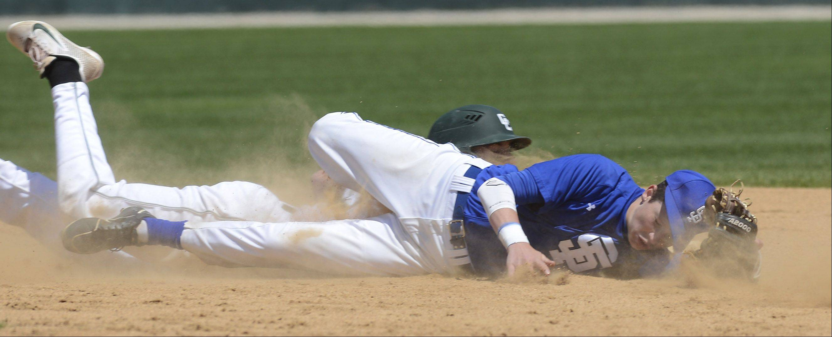 St. Francis second baseman Jack Ciombor lands on the dirt on a wild pickoff attempt on Grayslake Central base runner Matt Loeffl during the Class 3A state baseball semifinal at Silver Cross Field in Joliet Friday.