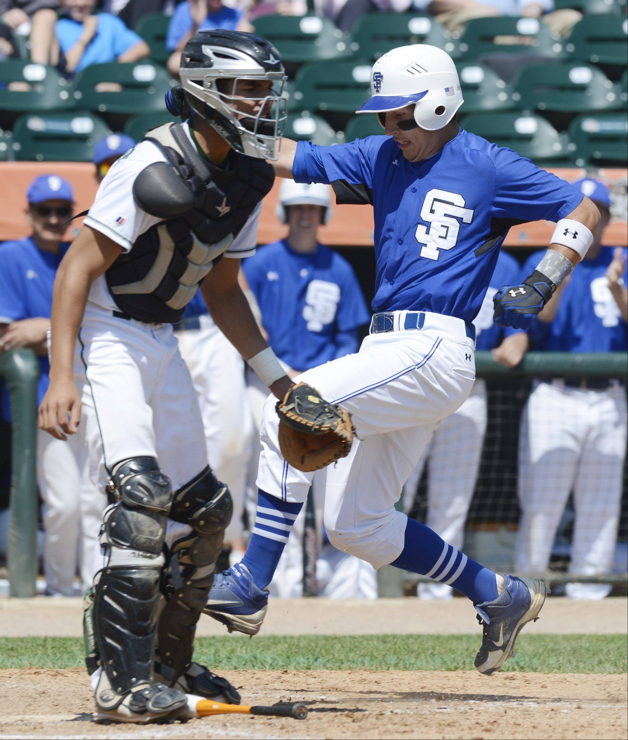Joe Croci of St. Francis runs past Grayslake Central catcher Freddie Landers as her scores during the Class 3A state baseball semifinal at Silver Cross Field in Joliet Friday.