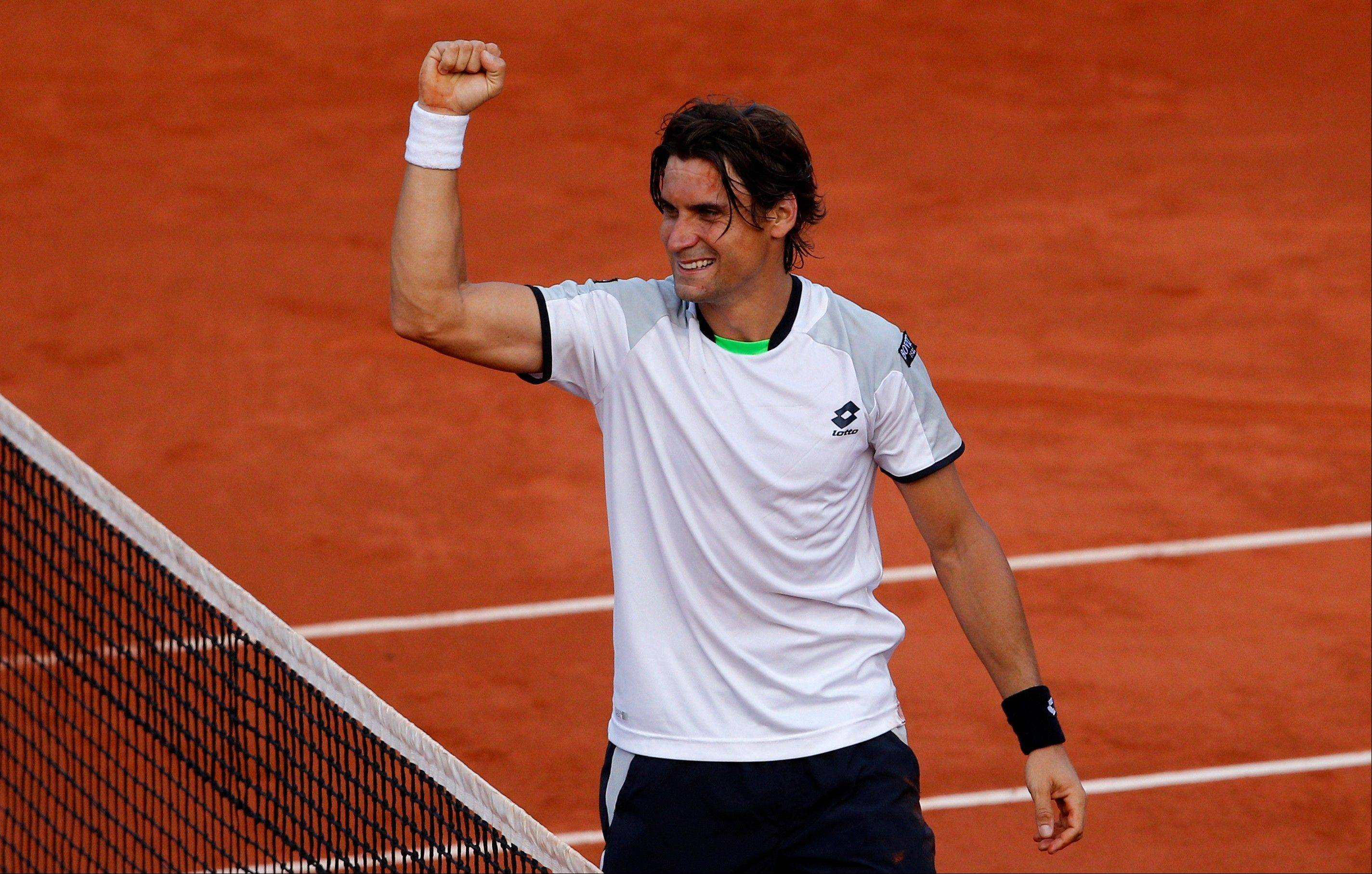 David Ferrer clenches his fist Friday after defeating France's Jo-Wilfried Tsonga during their semifinal match of the French Open at the Roland Garros stadium in Paris. Ferrer won 6-1, 7-6, 6-2.