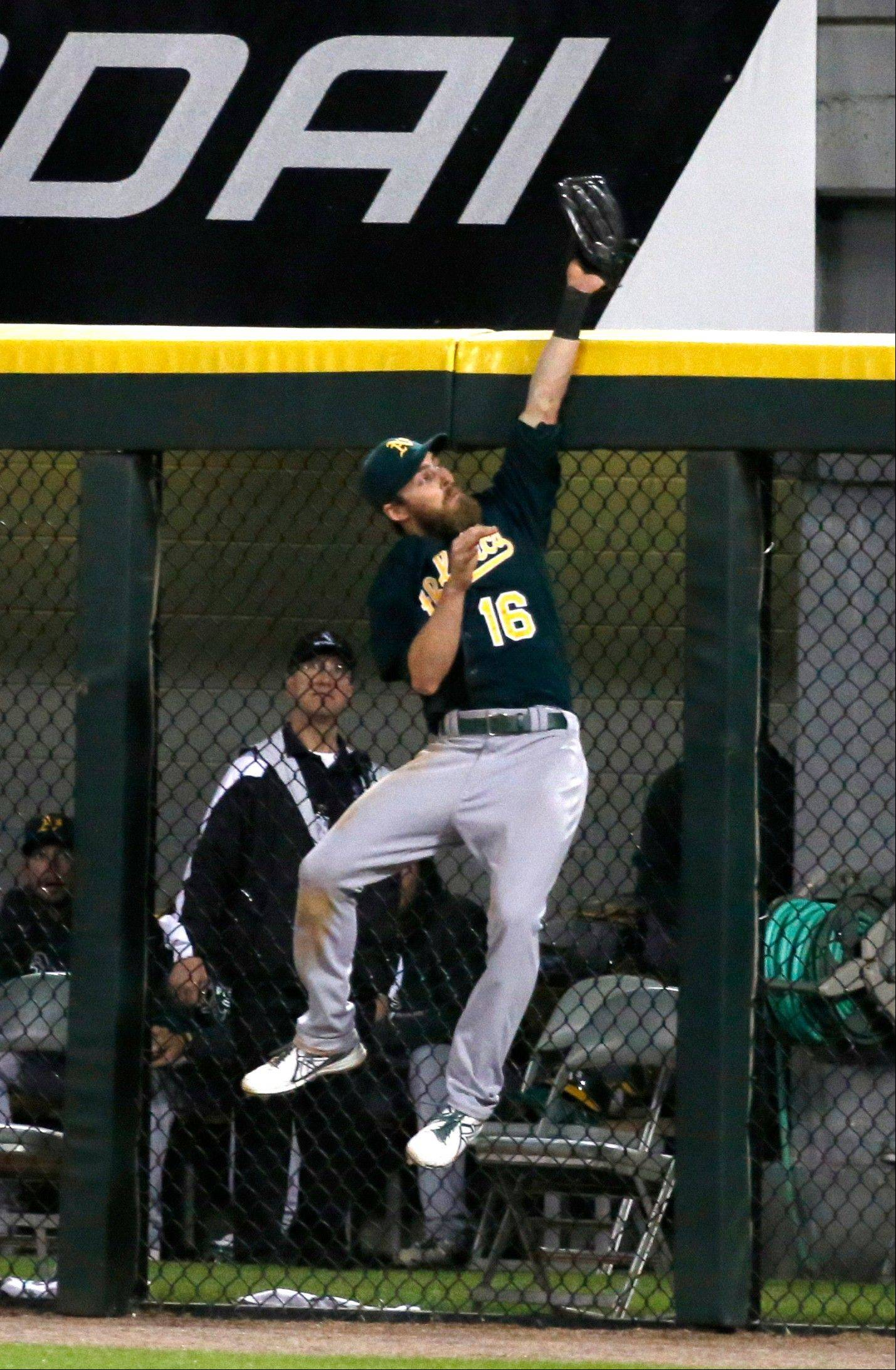 Athletics right fielder Josh Reddick makes a leaping catch of a drive by the White Sox' Conor Gillaspie that ended the game Friday at U.S. Cellular Field.