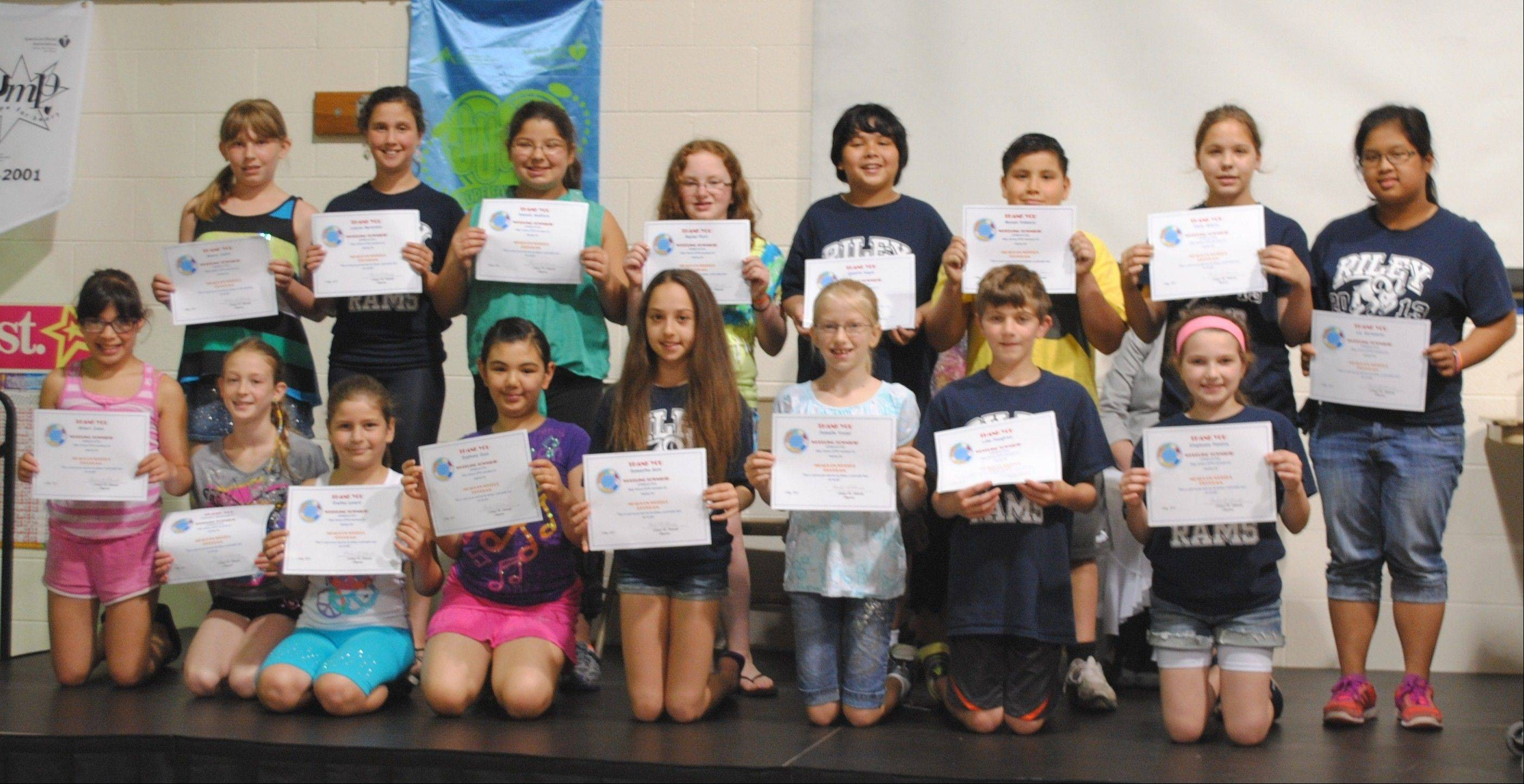 Riley Elementary School SPIN (Supporting People in Need) members proudly display certificates of achievement received from Wheeling Township Supervisor Michael Schroeder during an awards ceremony held May 30.