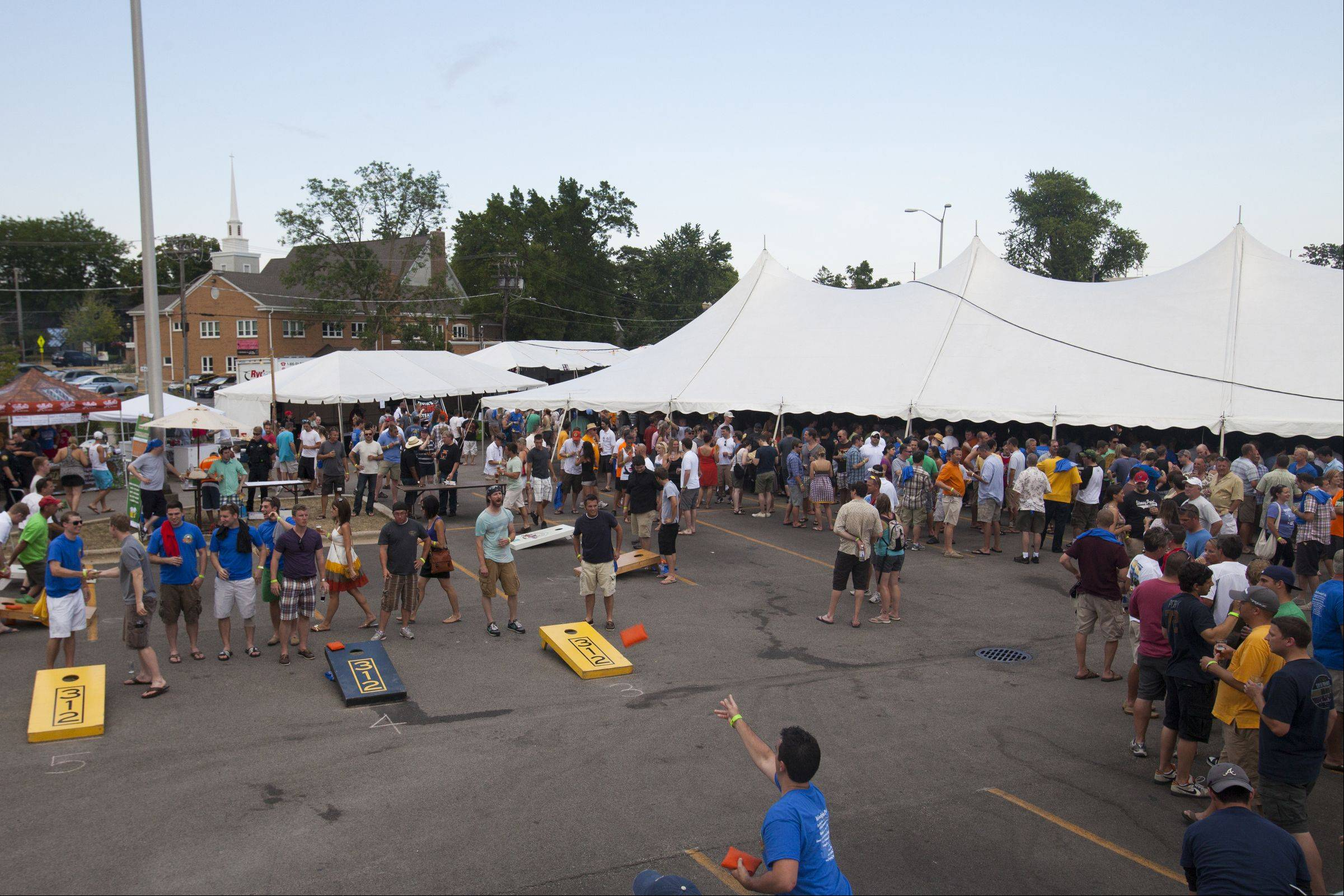 Many taste as others play at last year's Barrington Brew Fest. The 10th annual Barrington Brew Fest is scheduled for July 13 and will include regional craft breweries, live music, tasty food and a bean bag tournament.