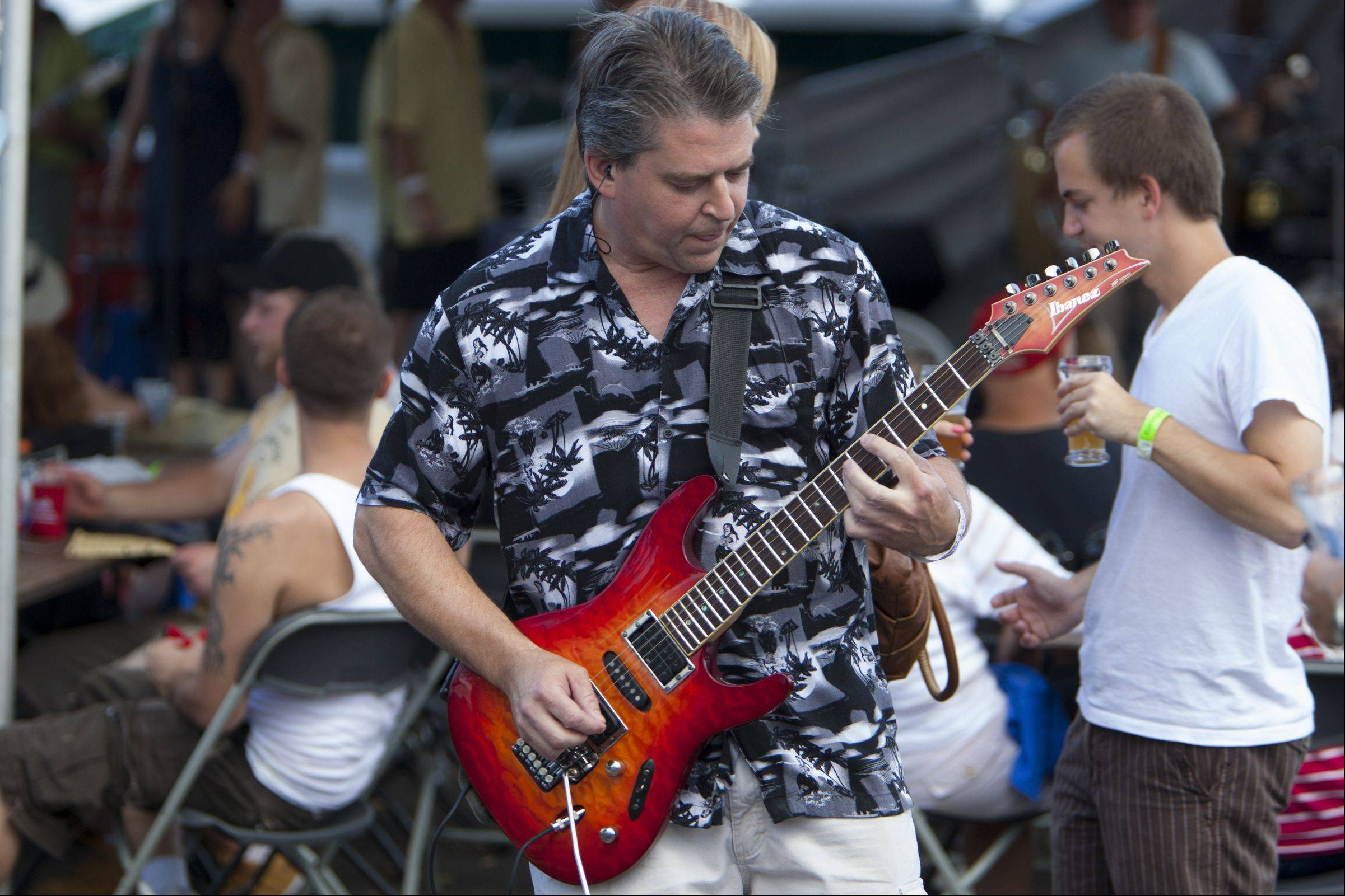 "Al Hamilton of ""Second Time Around"" steps out into the audience to play a solo during last year's Barrington Brew Fest. The group will also provide the entertainment for this year's fest scheduled for July 13."
