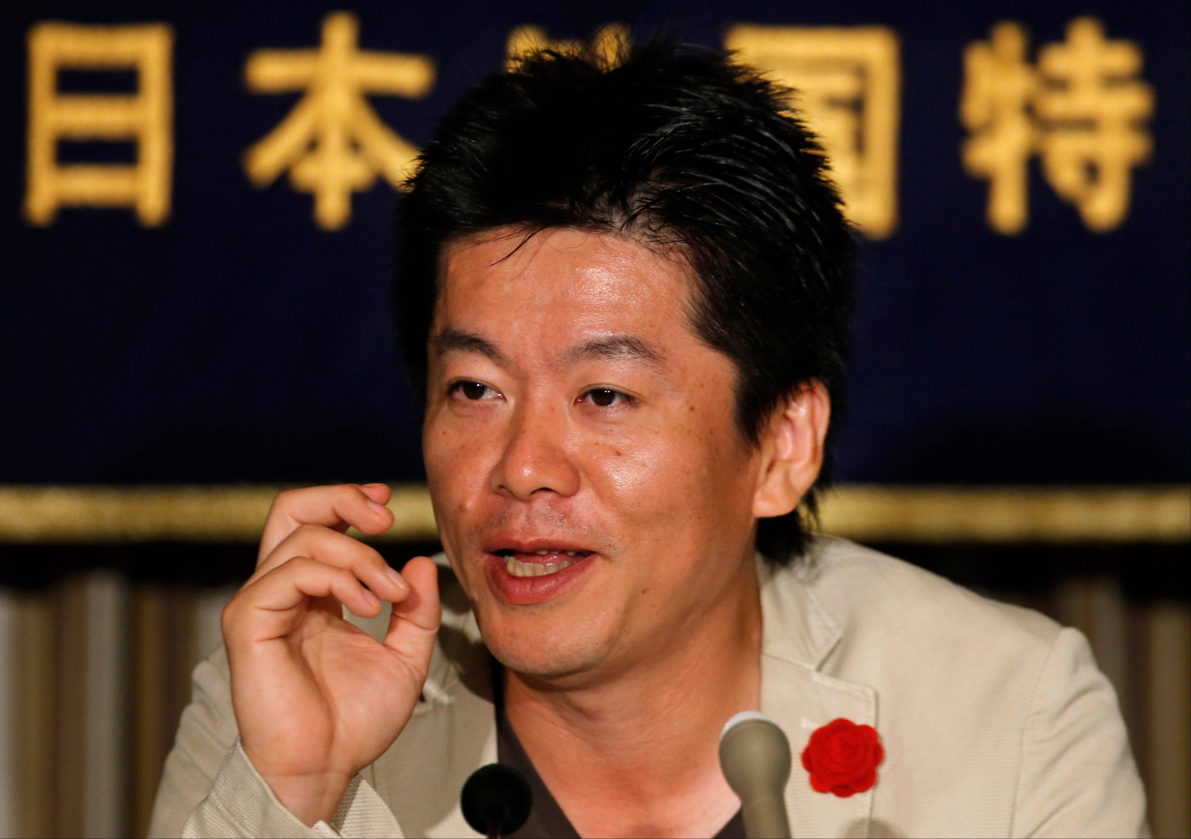 Takafumi Horie, the Japanese dot.com celebrity imprisoned for nearly two years on securities fraud charges, is cooking up dozens of ventures and is demanding the nation reduce regulations to give more opportunities to young entrepreneurs.