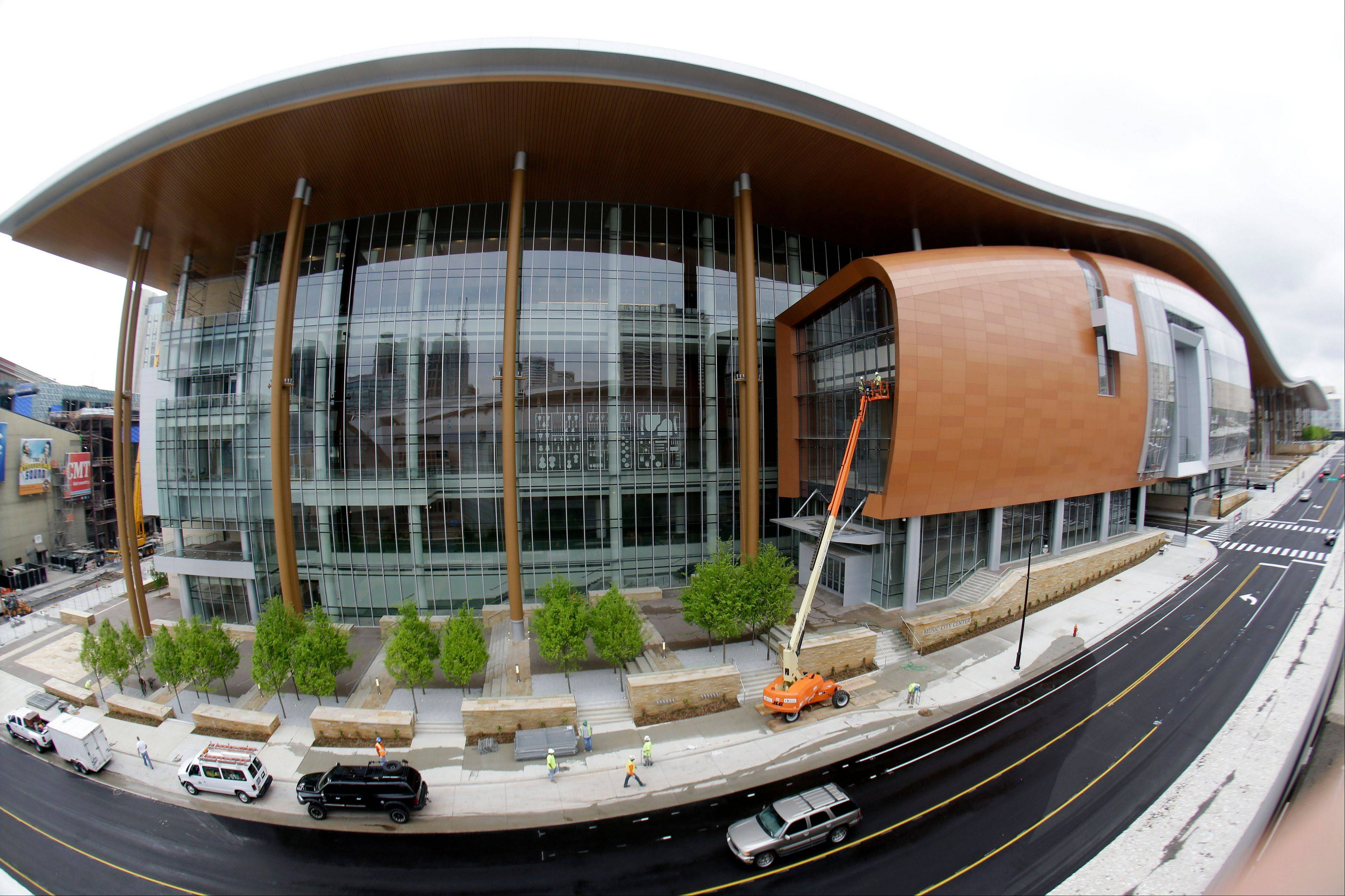 The new Music City Center is transforming the look of downtown Nashville with its wavy roof dominating six city blocks.