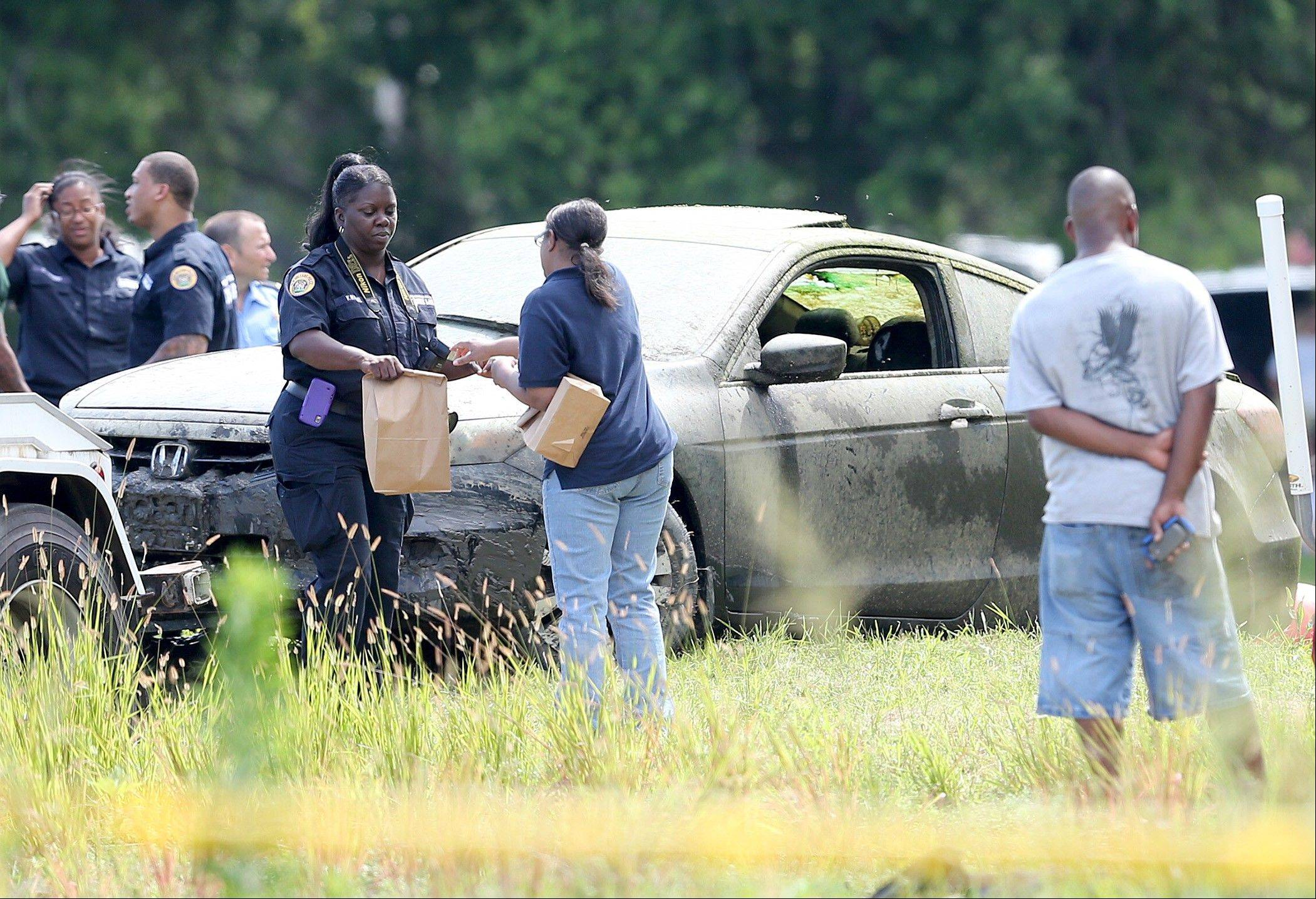 Crime scene technicians collect evidence Saturday from the Honda Accord belonging to teacher Terrilynn Monette, who has been missing since leaving a nearby bar in early March.