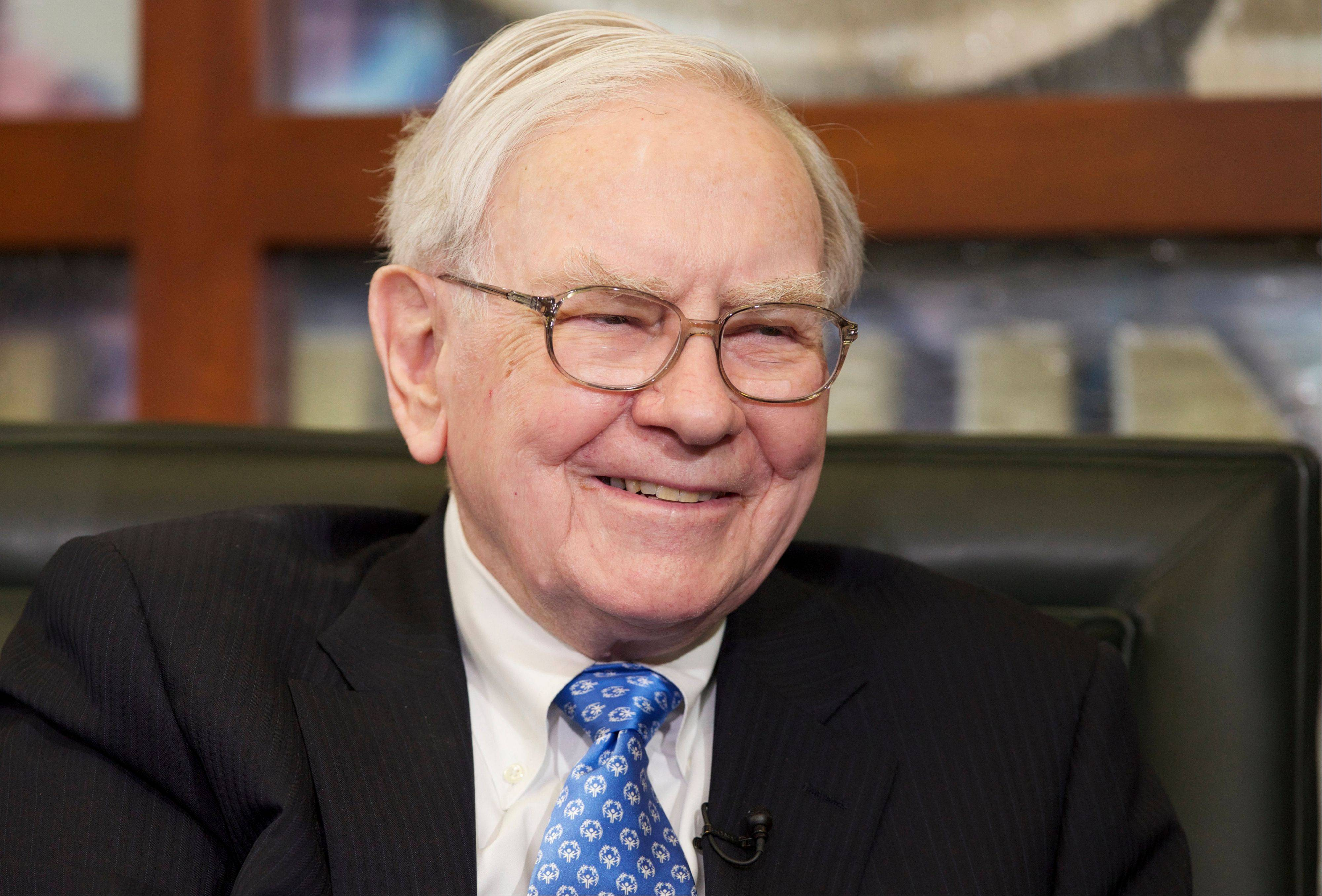 Associated Press/May 6, 2013 Warren Buffett smiles during a television interview in Omaha, Neb.