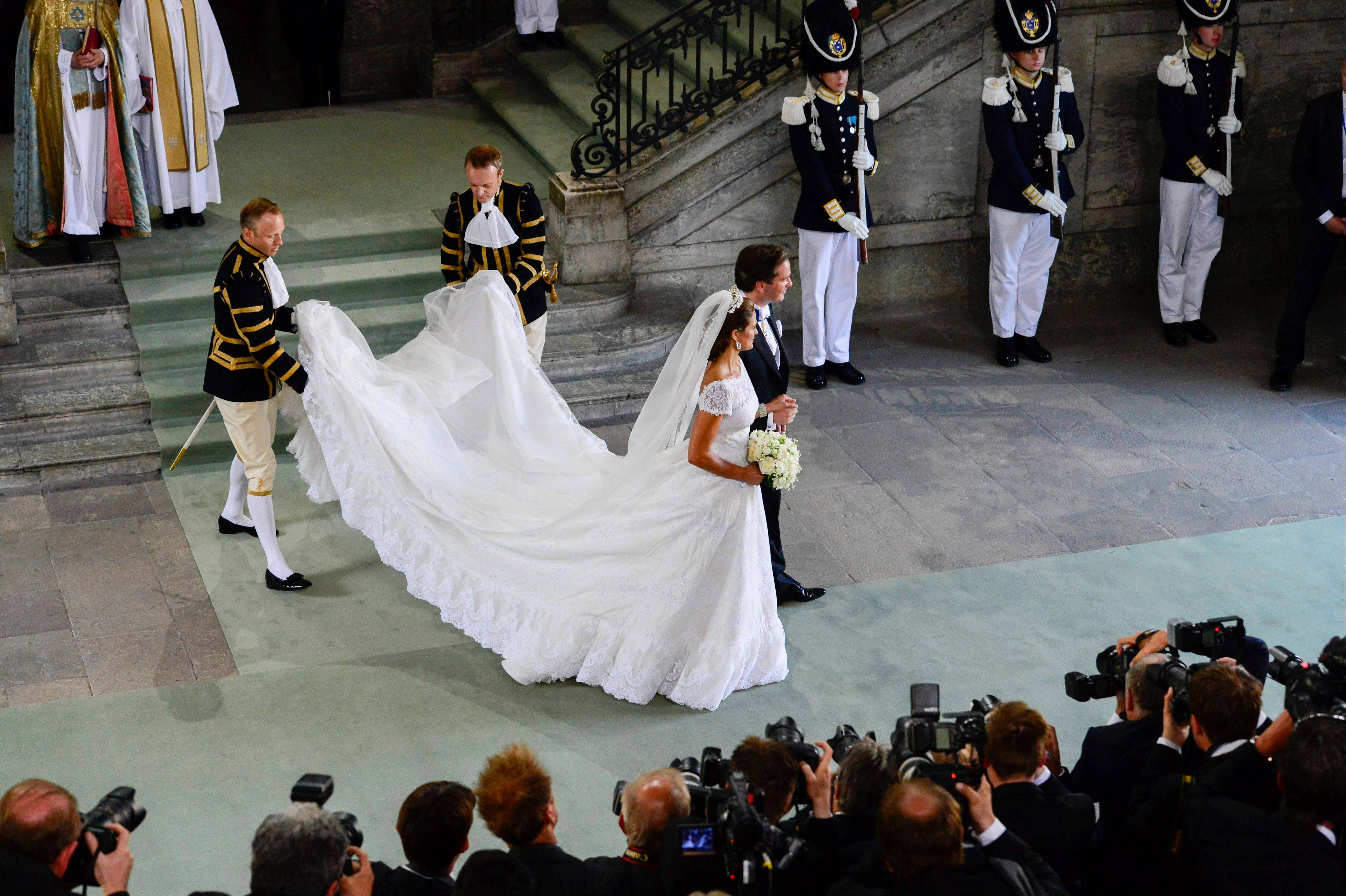 Sweden's Princess Madeleine and Christopher O'Neill smile outside the Royal Chapel after their wedding ceremony in Stockholm, Saturday June 8.