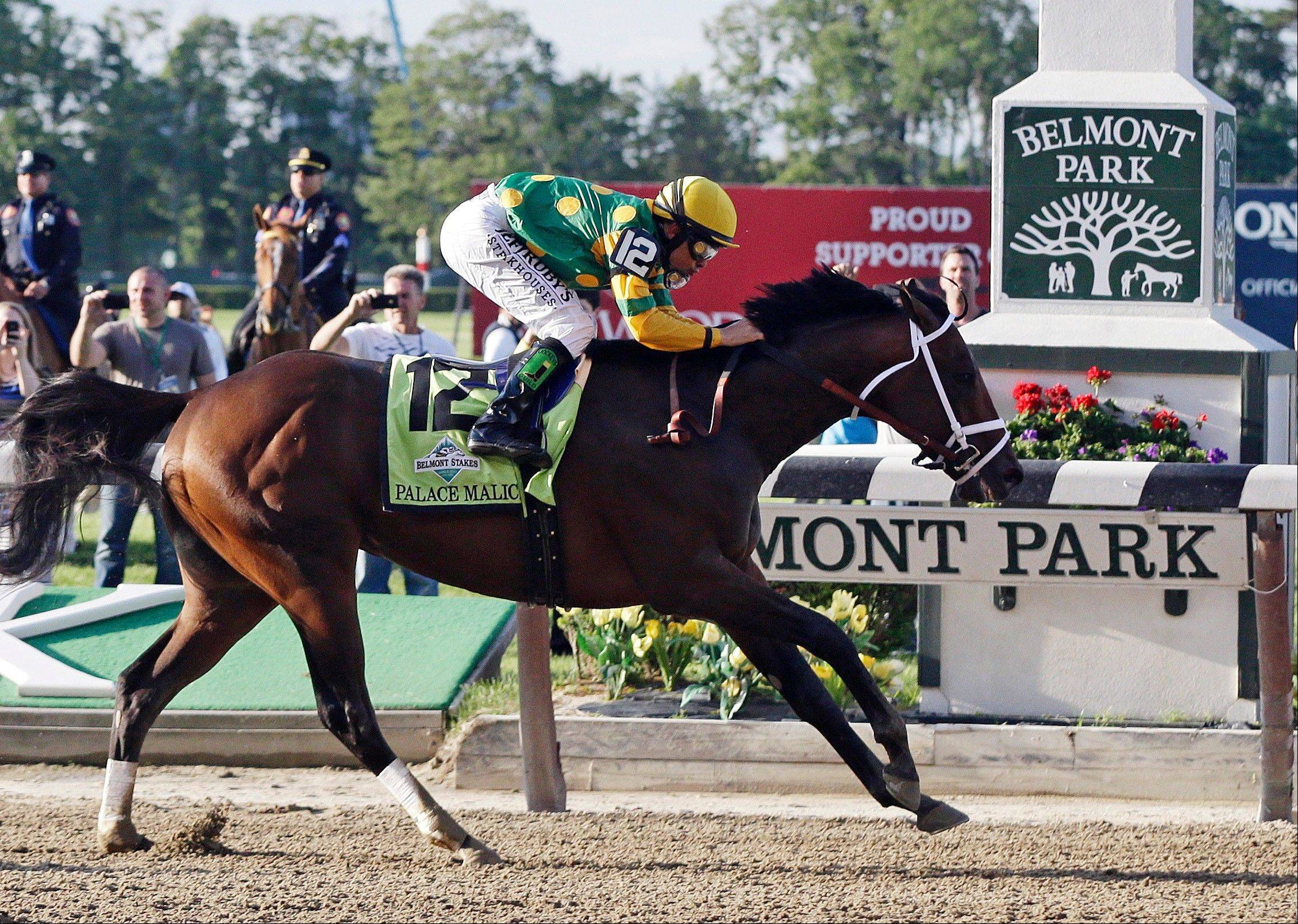Palace Malice, ridden by jockey Mike Smith, crosses the finish line to win the the 145th Belmont Stakes horse race at Belmont Park Saturday, June 8, 2013, in Elmont, N.Y. (AP Photo/Frank Franklin II)