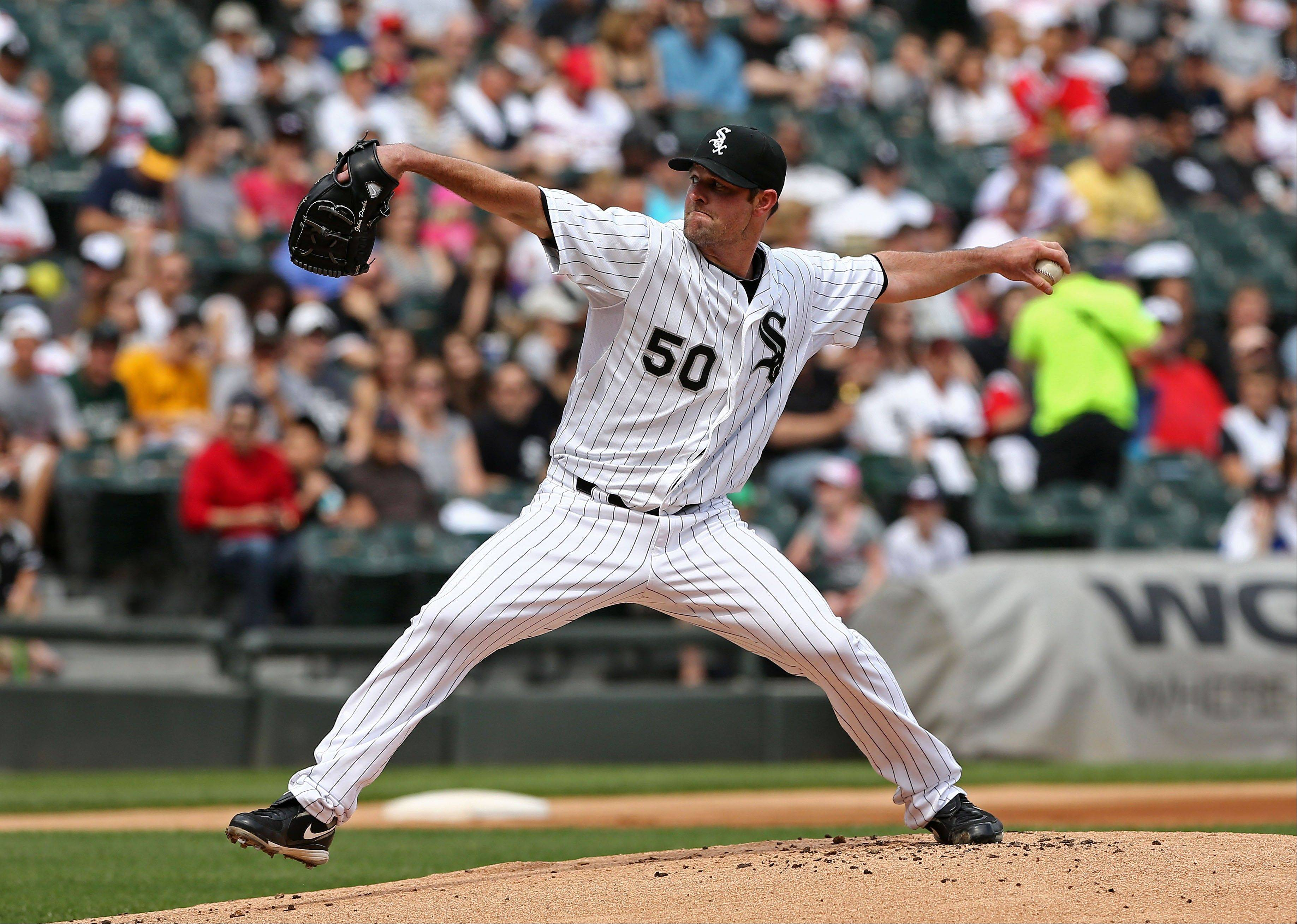Chicago White Sox starting pitcher John Danks throws to the Oakland Athletics during the first inning in a baseball game on Saturday, June 8, 2013. (AP Photo/Charles Cherney)