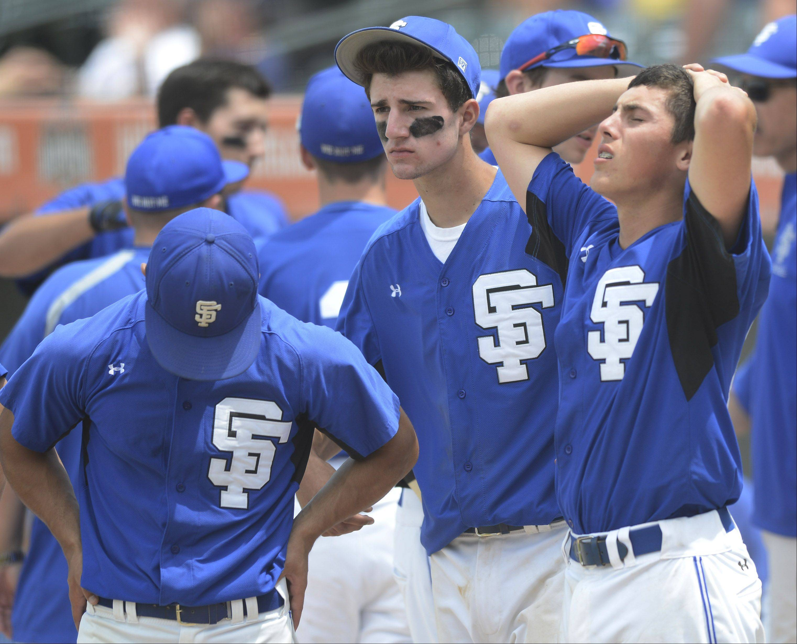 St. Francis players react as Joliet Catholic celebrates its 5-0 win during the Class 3A state baseball championship game at Silver Cross Field in Joliet Saturday.