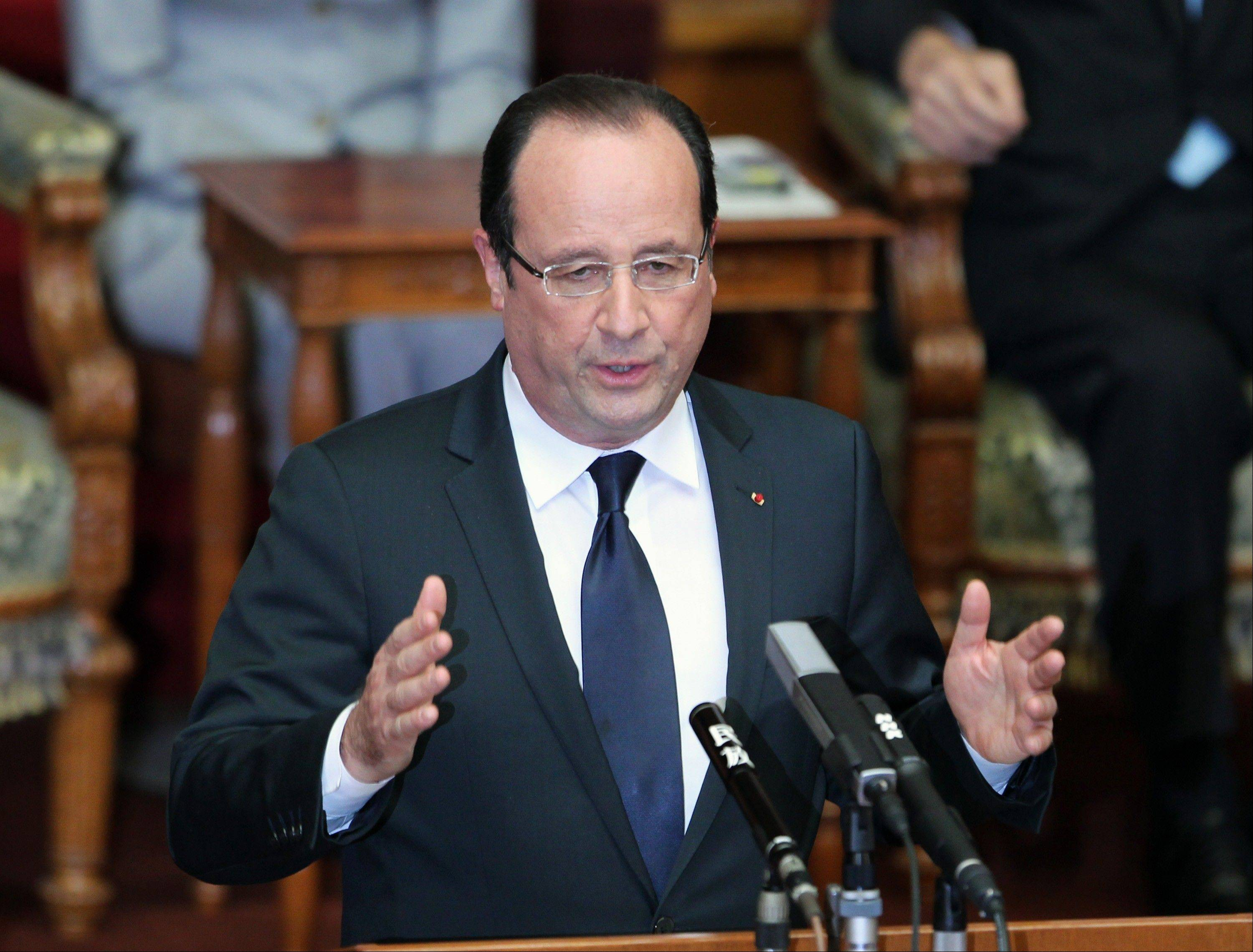 Francois Hollande, France's president, delivers a speech Friday in the upper house of Parliament in Tokyo, Japan.