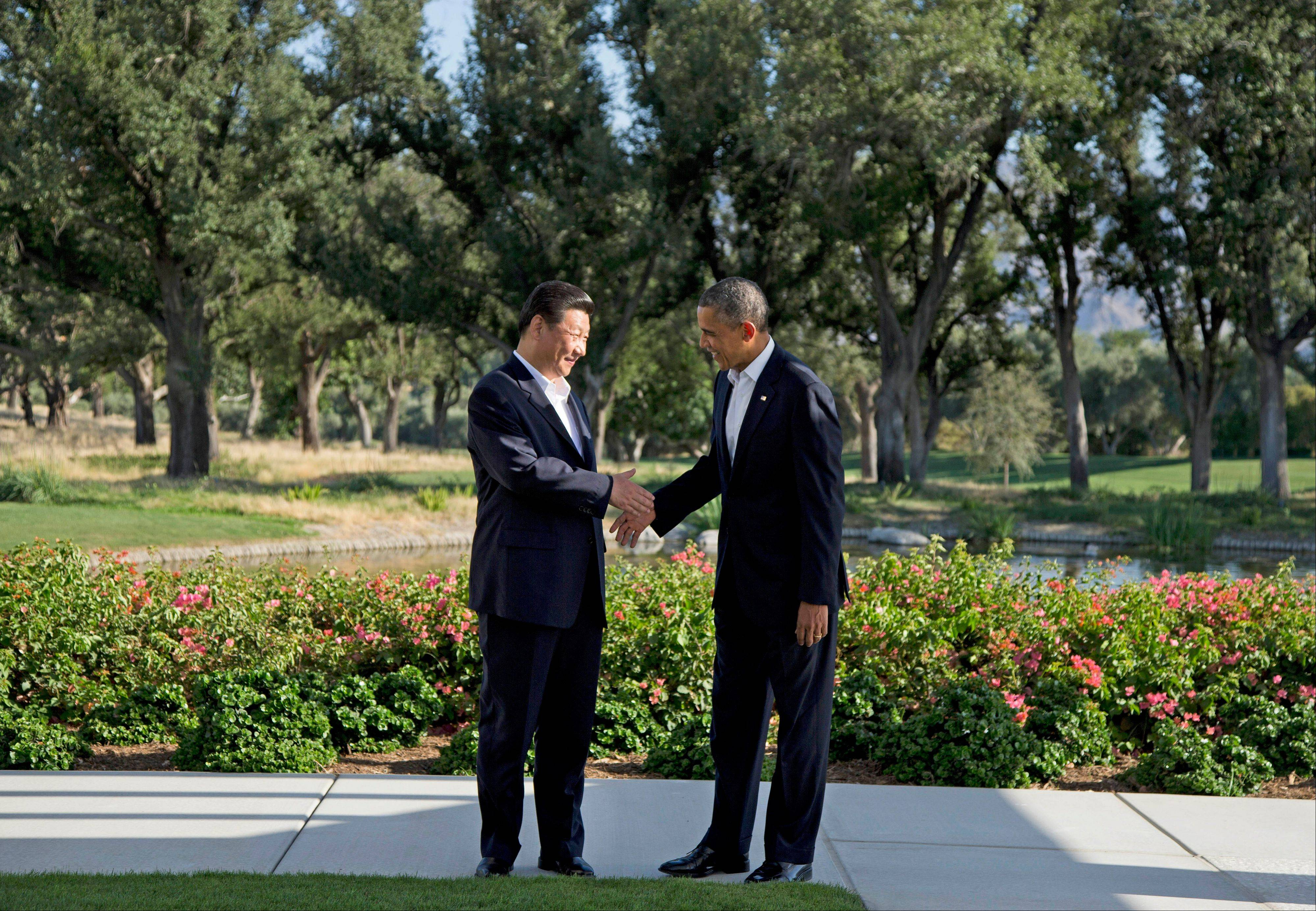 President Barack Obama shakes hands with Chinese President Xi Jinping Friday at the Annenberg Retreat at Sunnylands as they meet for talks, in Rancho Mirage, Calif.