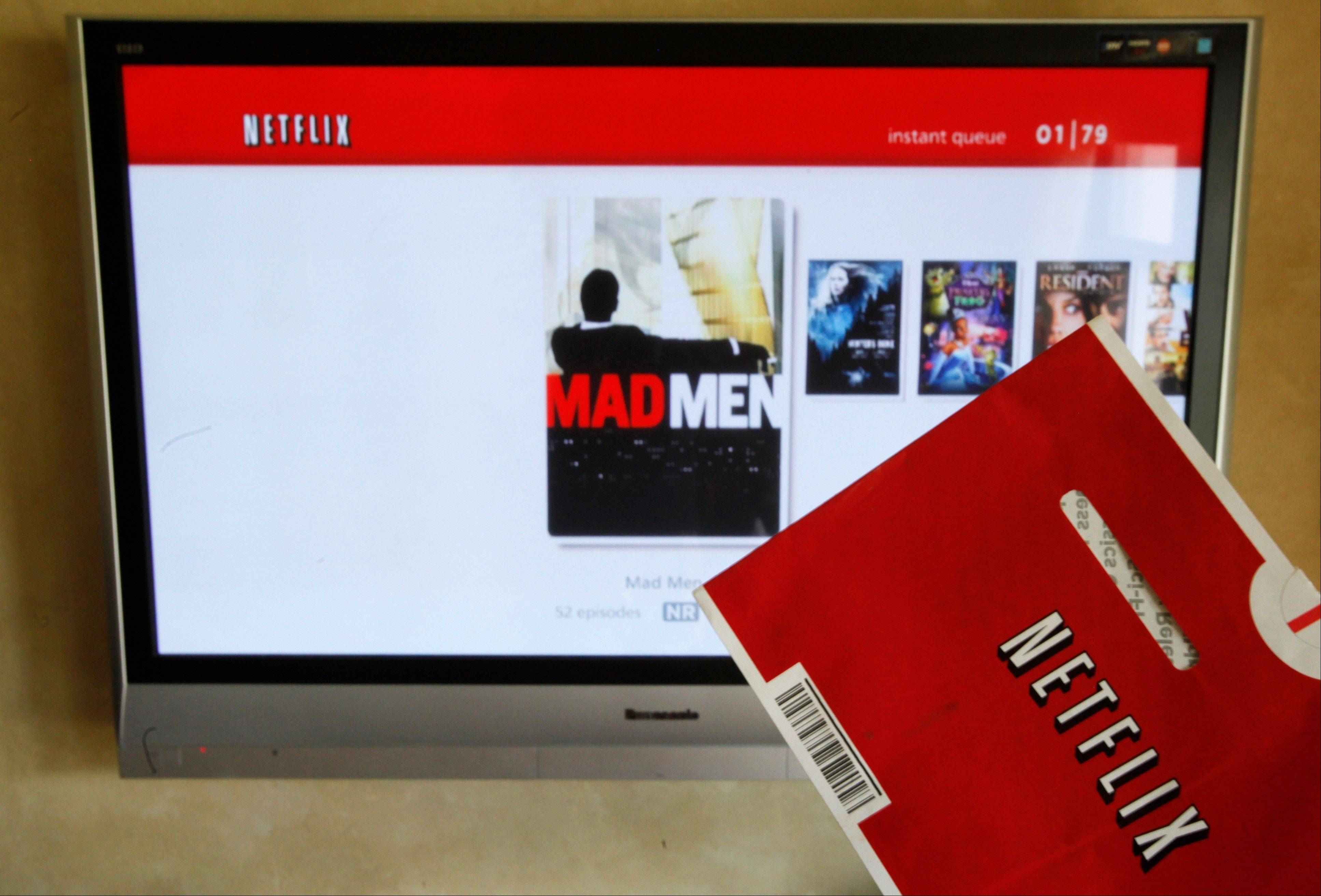 A Netflix DVD envelope and Netflix on-screen television menu are shown in Surfside, Fla. Thinking about how you use your Netflix, Hulu or other video account, can lead to potentially cost-saving measures, depending on what features you desire and actually use the most.
