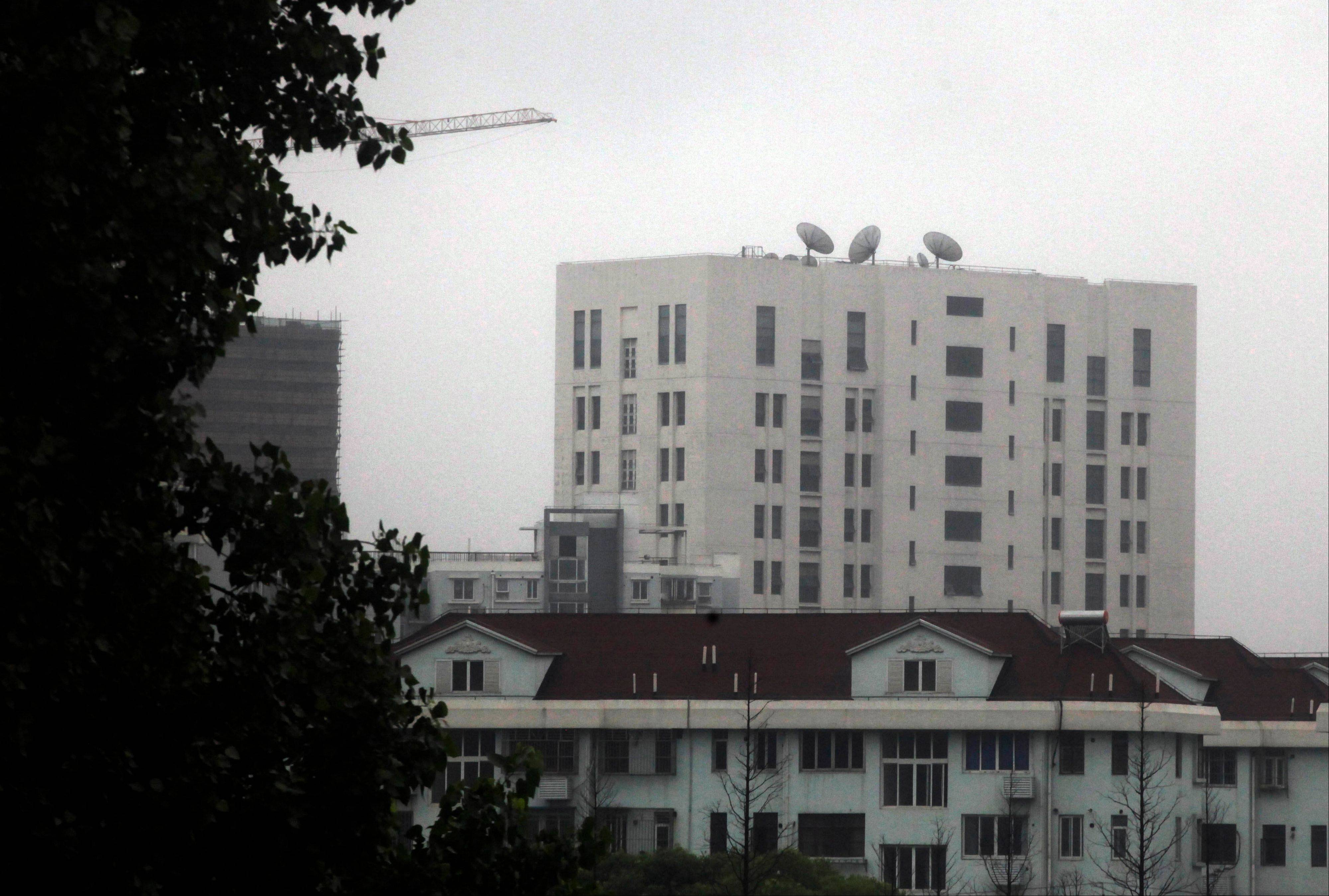 "This May 31, 2013 photo shows the building housing ""Unit 61398"" of the People�s Liberation Army, center top, in the outskirts of Shanghai, China. After years of quiet and largely unsuccessful diplomacy, the U.S. has brought its persistent computer-hacking problems with China into the open, delivering a steady drumbeat of reports accusing Beijing�s government and military of computer-based attacks against America."