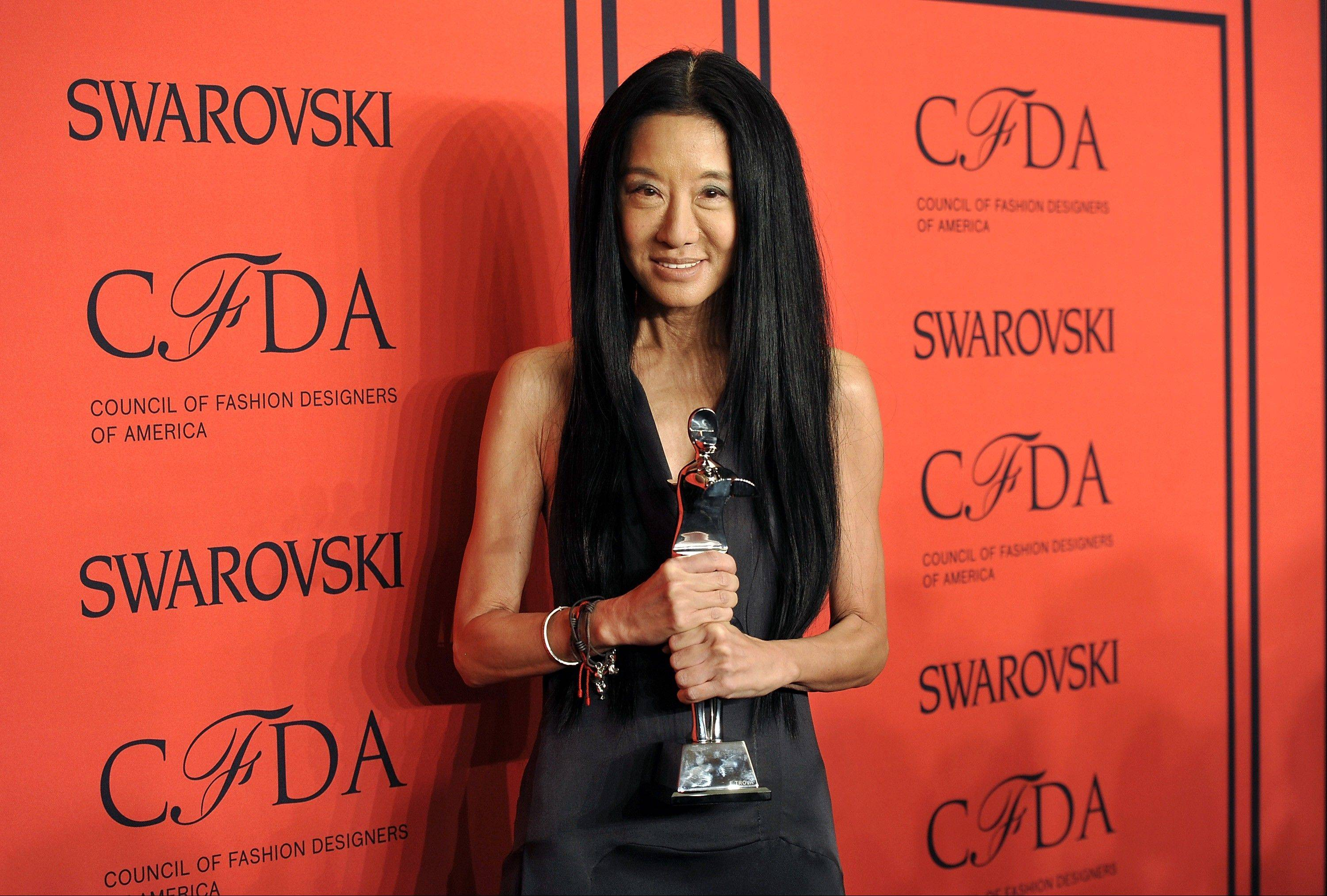 "Designer Vera Wang poses with her award for ""Lifetime Achievement"" at the 2013 CFDA Fashion Awards."