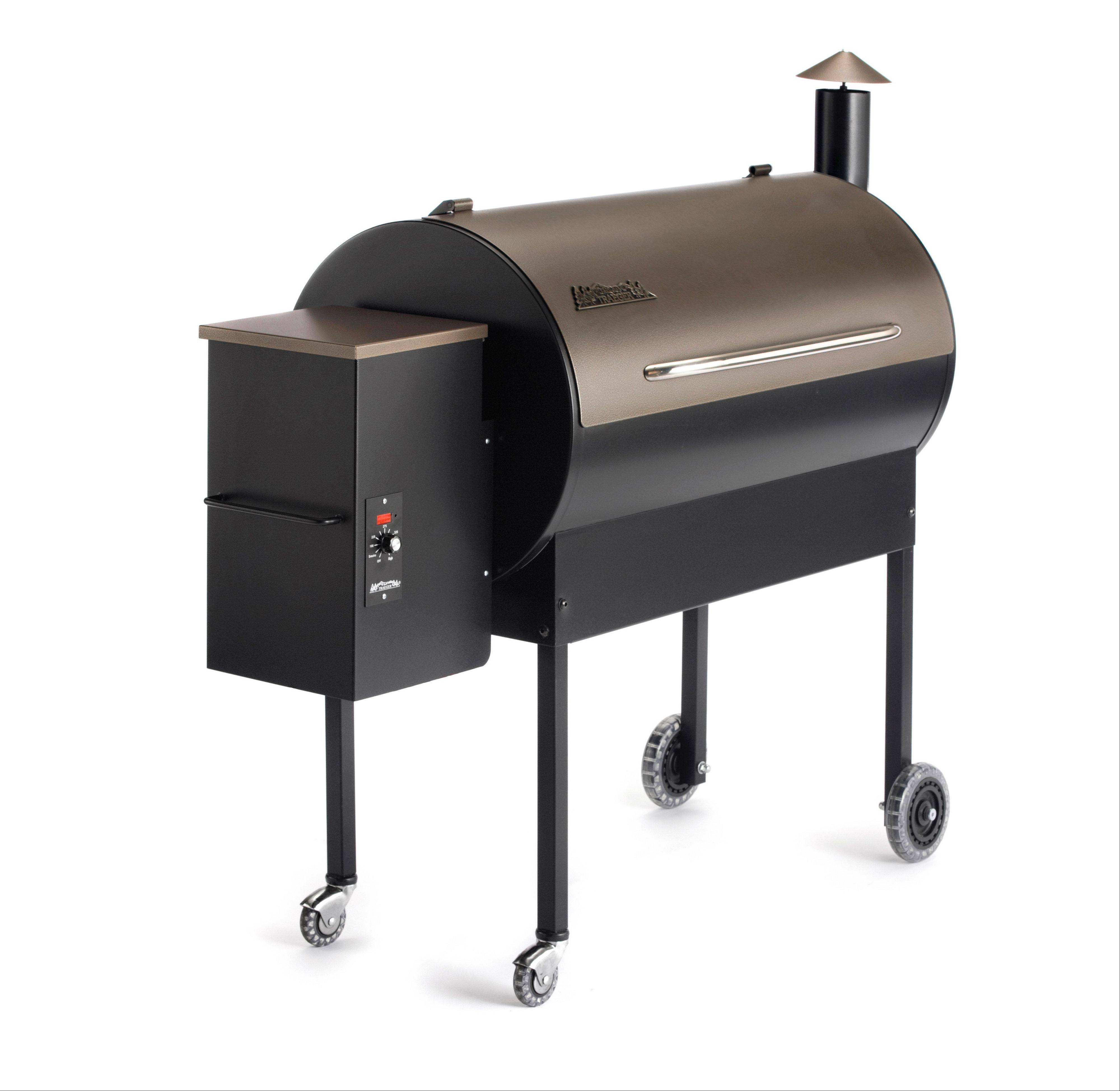 This Traeger grill burns wood pellets for a constant, even temperature.