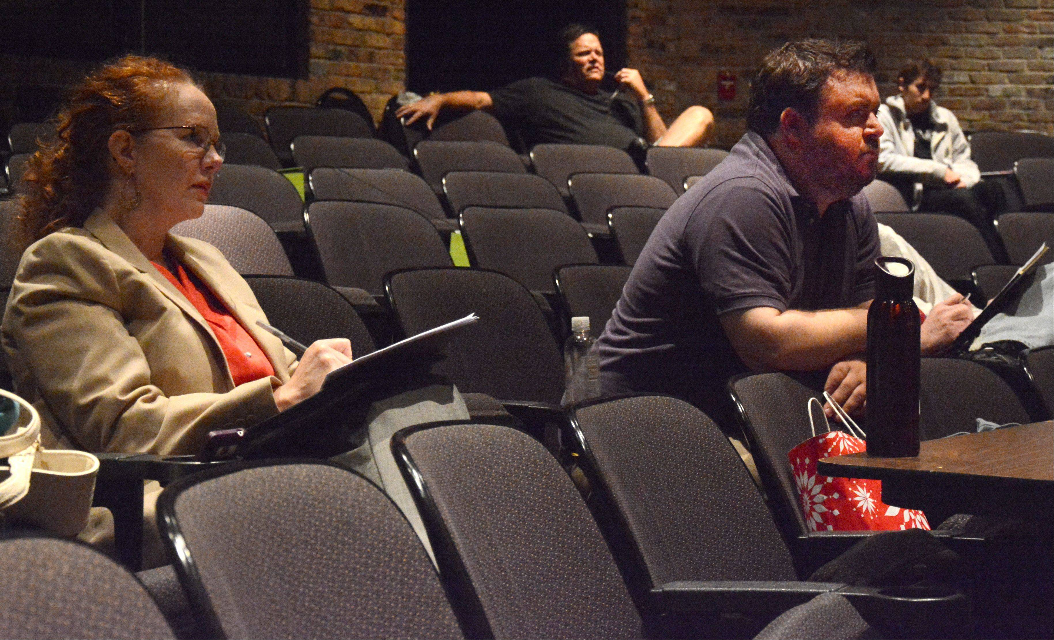 Judges Robin Hughes and Micky York take notes during Amy Powers' audition for Suburban Chicago's Got Talent Friday at the Metropolis Performing Arts Centre in Arlington Heights. Auditions continue today.