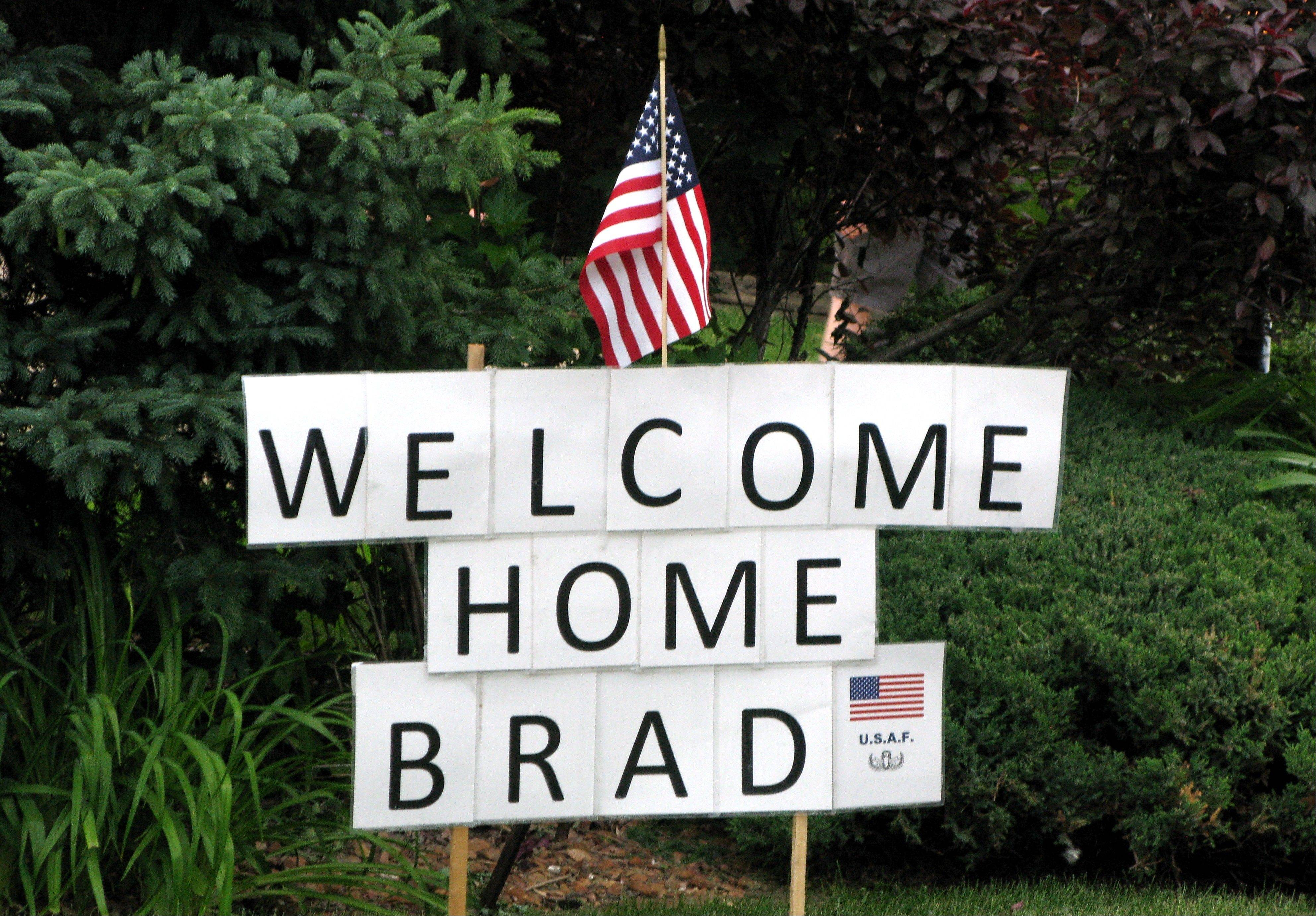 Welcome signs, blaring horns, roaring motorcycles and multiple American flags decorated the area for Bradley Taylor's return from active duty overseas.