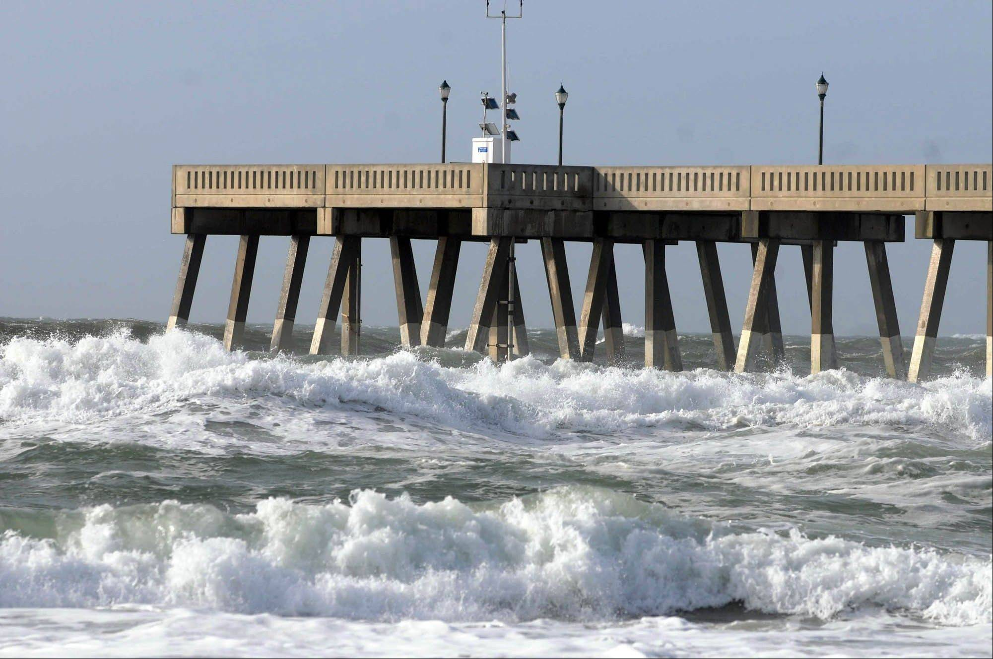 Waves crash against the pier Friday as Tropical Storm Andrea moves in on Wrightsville Beach in Wilmington, N.C.