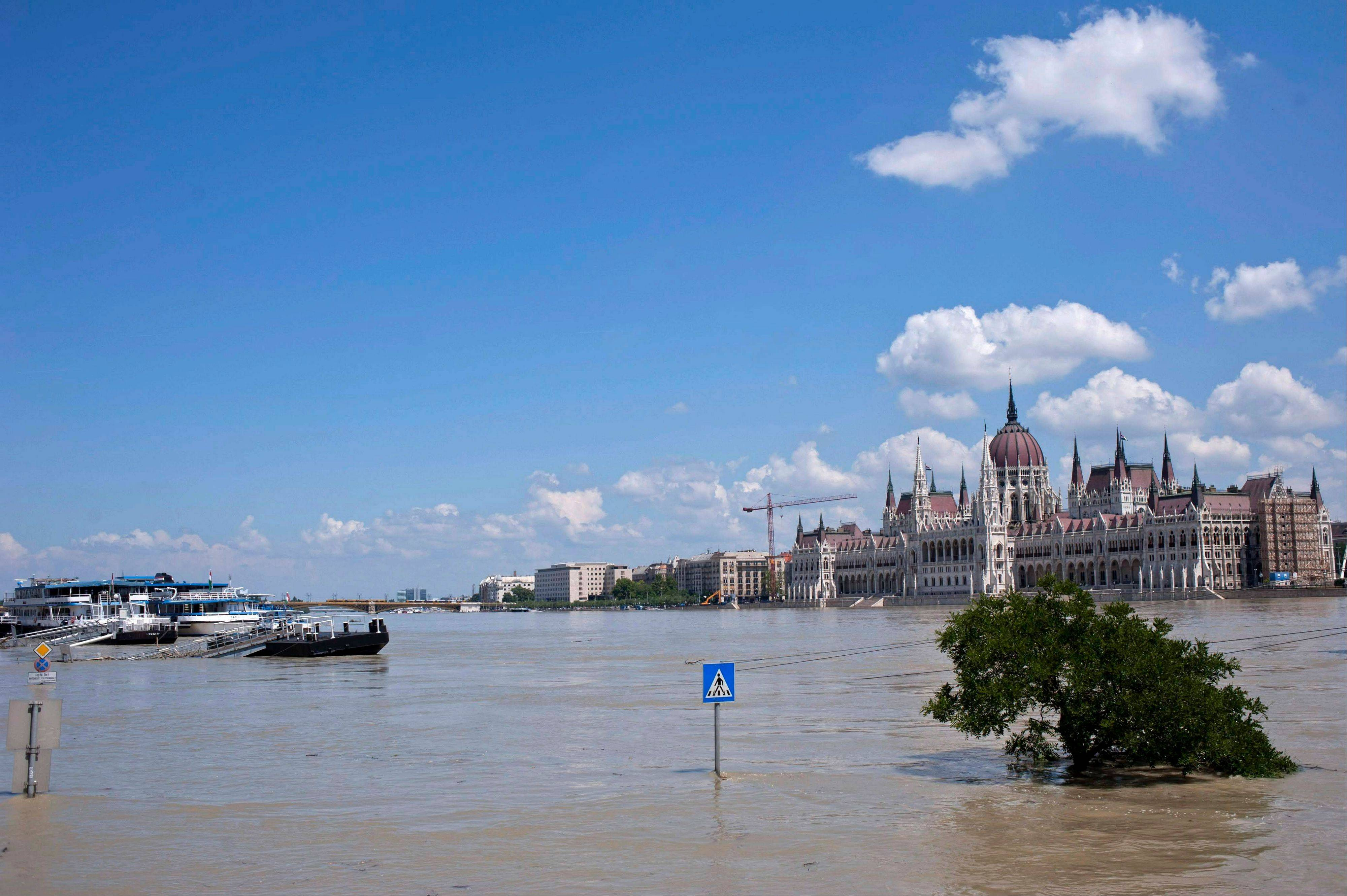 The Parliament building is seen across River Danube in Budapest, Hungary, Saturday, June 8. Heavy rainfalls in the past days caused flooding along rivers and lakes in Germany, Austria, Switzerland the Czech Republic and Hungary.