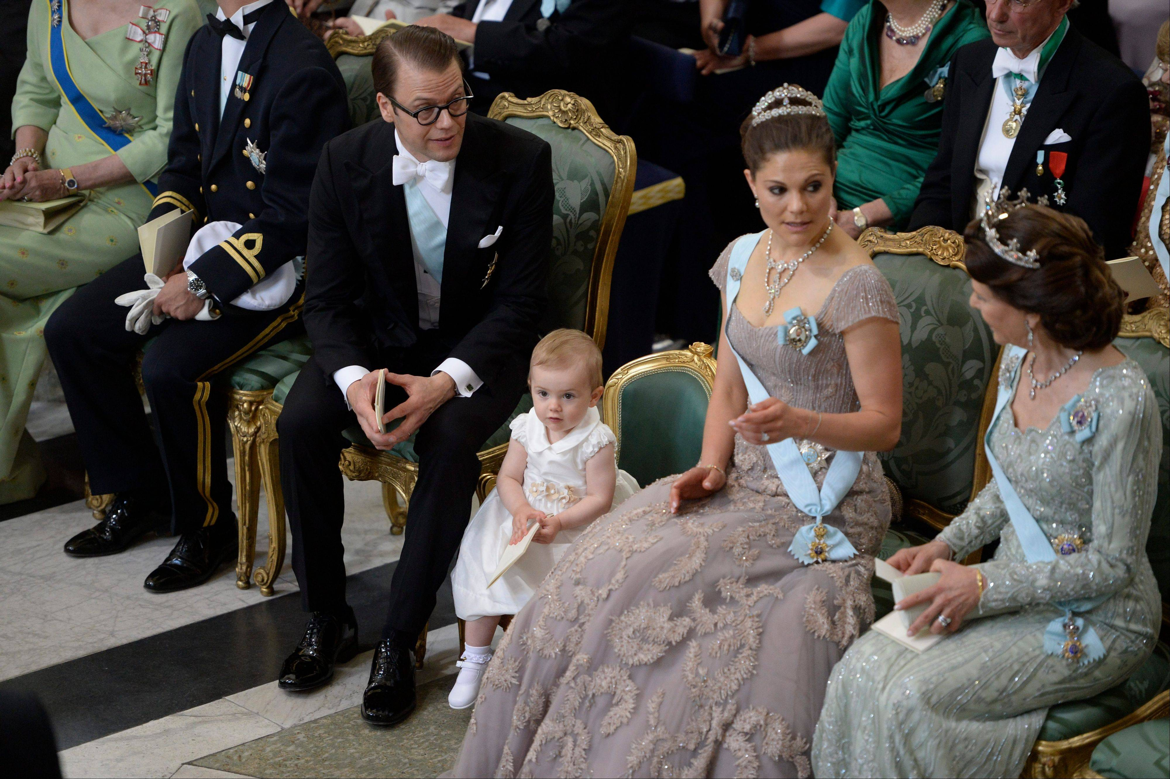 Prince Daniel, Princess Estelle, third right, Crown Princess Victoria, second right, and Queen Silvia of Sweden attend the wedding ceremony of Princess Madeleine and Christopher O'Neill at the Royal Chapel in Stockholm, Saturday June 8.