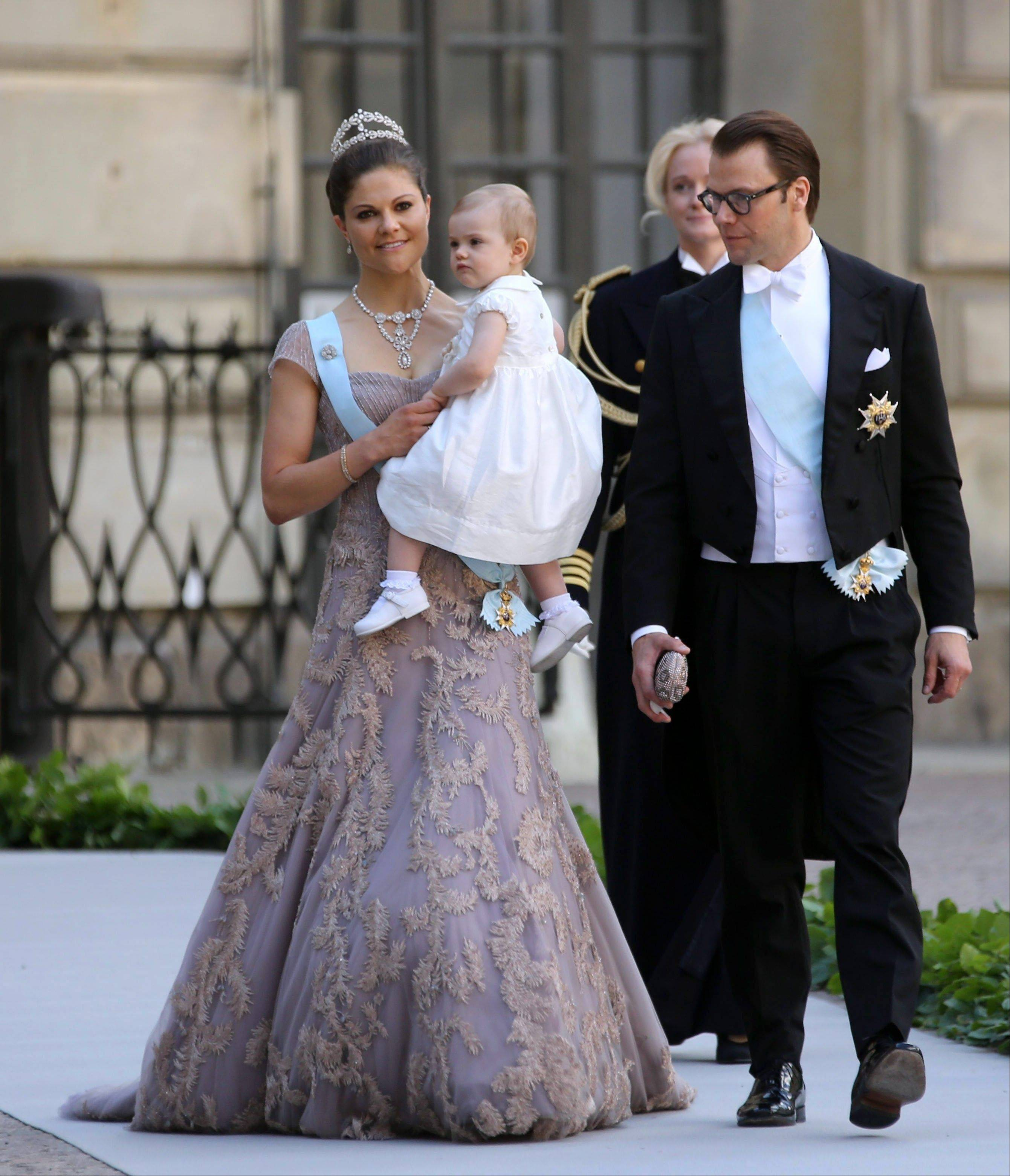 Crown Princess Victoria, Princess Estelle and Prince Daniel of Sweden arrives to the Royal Chapel before the wedding of Sweden's Princess Madeleine and New York banker Christopher O'Neill, in Stockholm Saturday June 8.