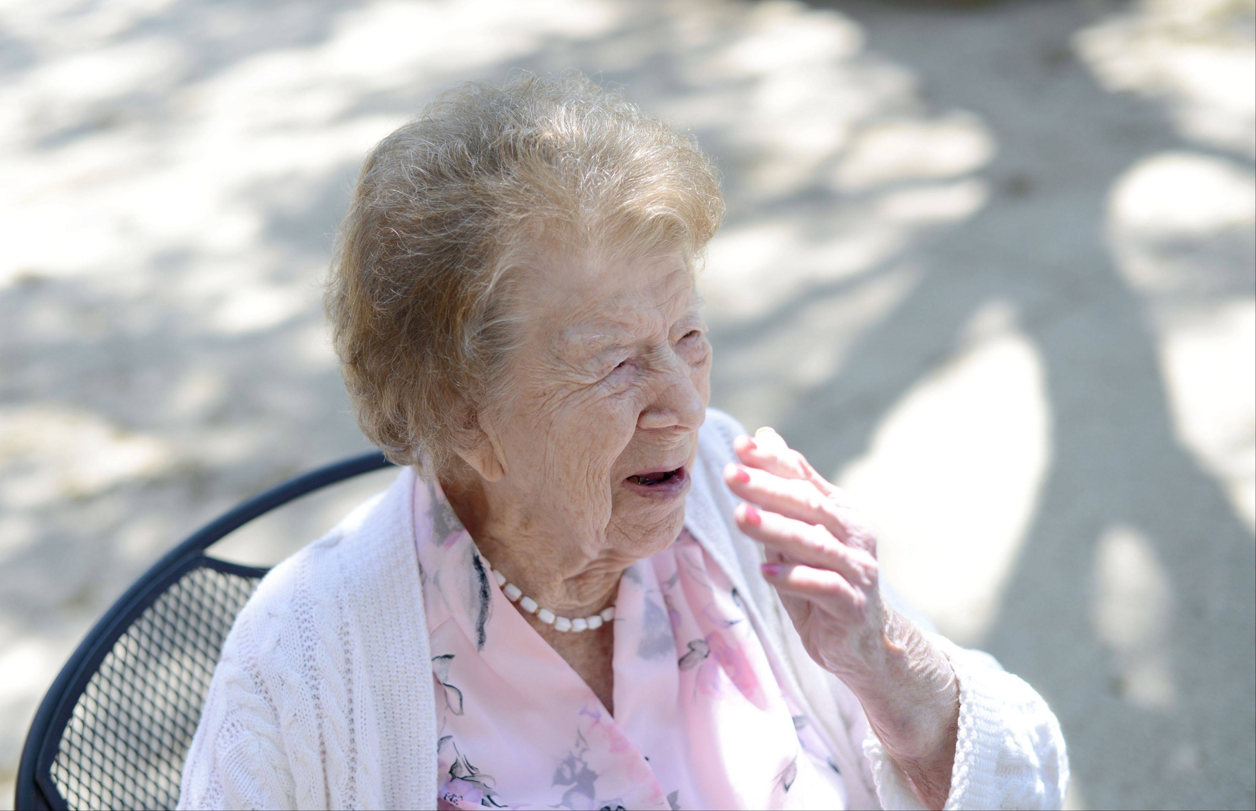 "Lena Agnes ""Aggie"" Petzinger, a resident of Tower Hill Healthcare Center in South Elgin, laughs while talking about the things she has done in her life. She'll be 102 on Sunday."