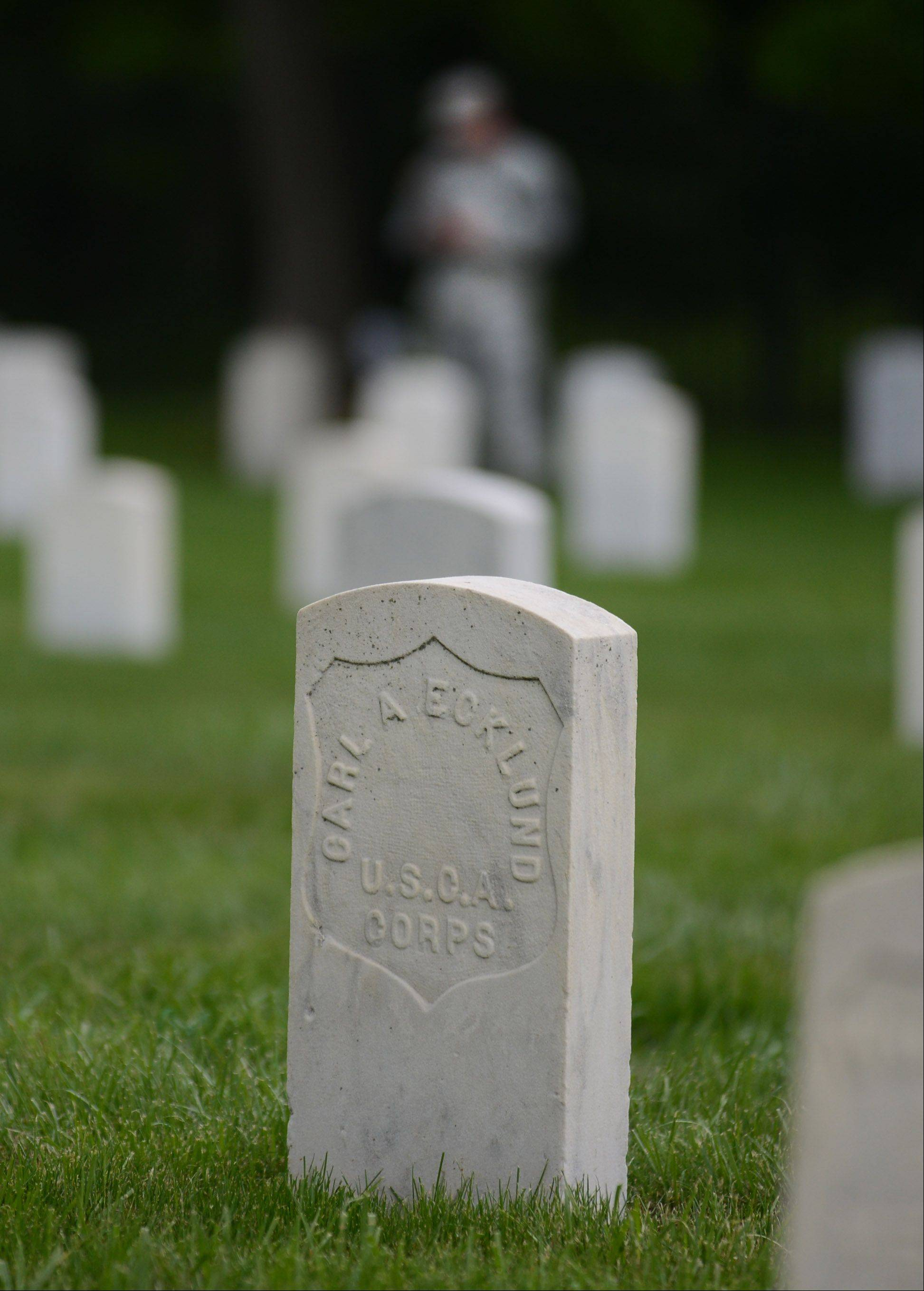Soldiers from Fort McCoy in Wisconsin are part of a team documenting grave markers at the Fort Sheridan Cemetery.