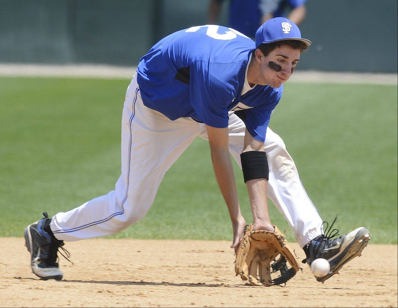 St. Francis shortstop Tim Zettinger fields a groundball during the Class 3A state baseball championship game against Joliet Catholic at Silver Cross Field in Joliet Saturday.