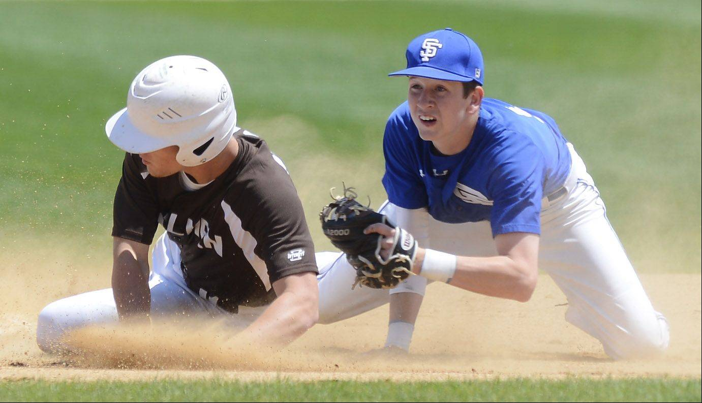 St. Francis second baseman Jack Ciombor looks call after tagging out Joliet Catholic's Nick Morrison to end the first inning during the Class 3A state baseball championship game at Silver Cross Field in Joliet Saturday.