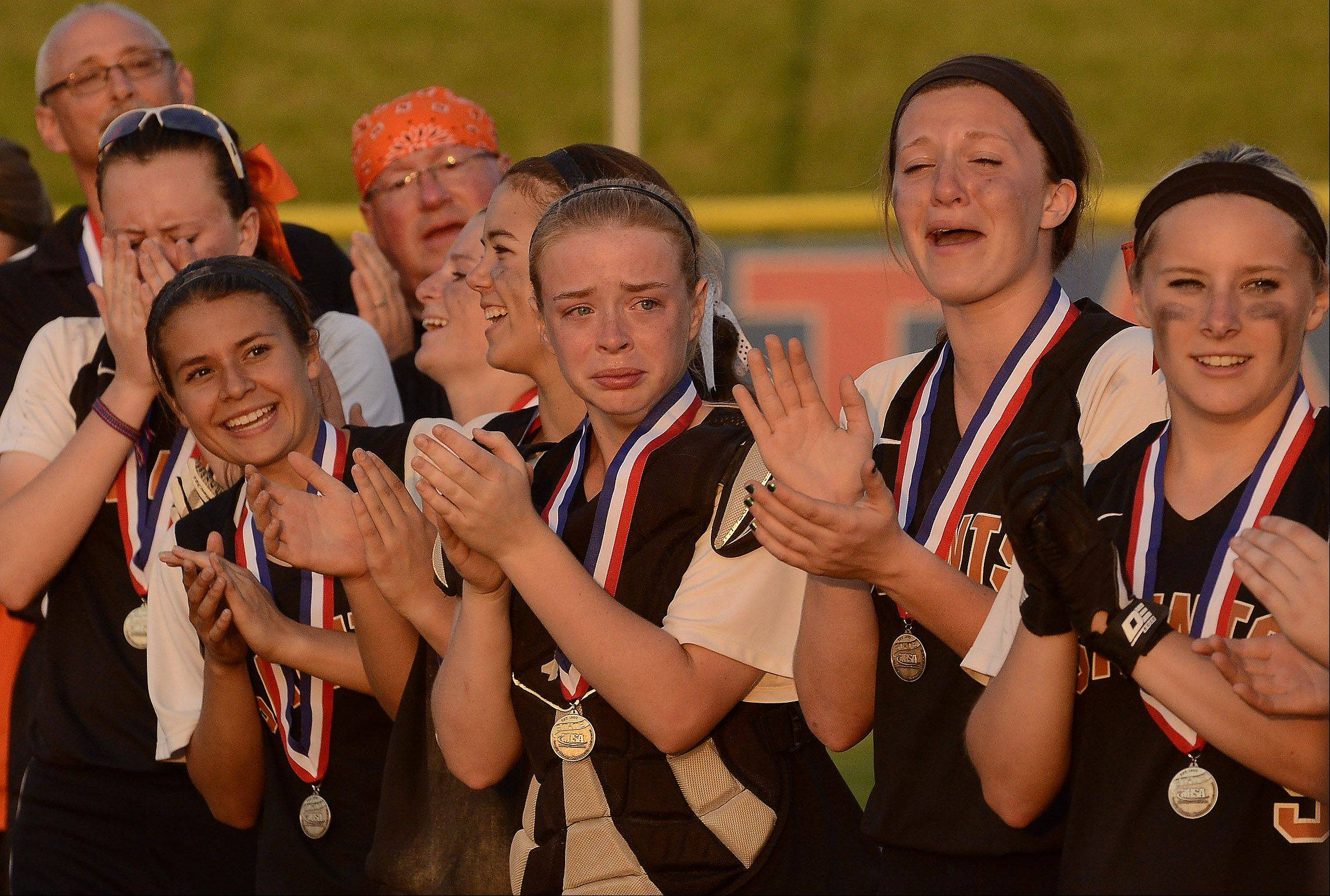 Among tears and smiles, St. Charles East players receive their 2nd place medals after losing to Minooka in the Class 4A softball championship game.