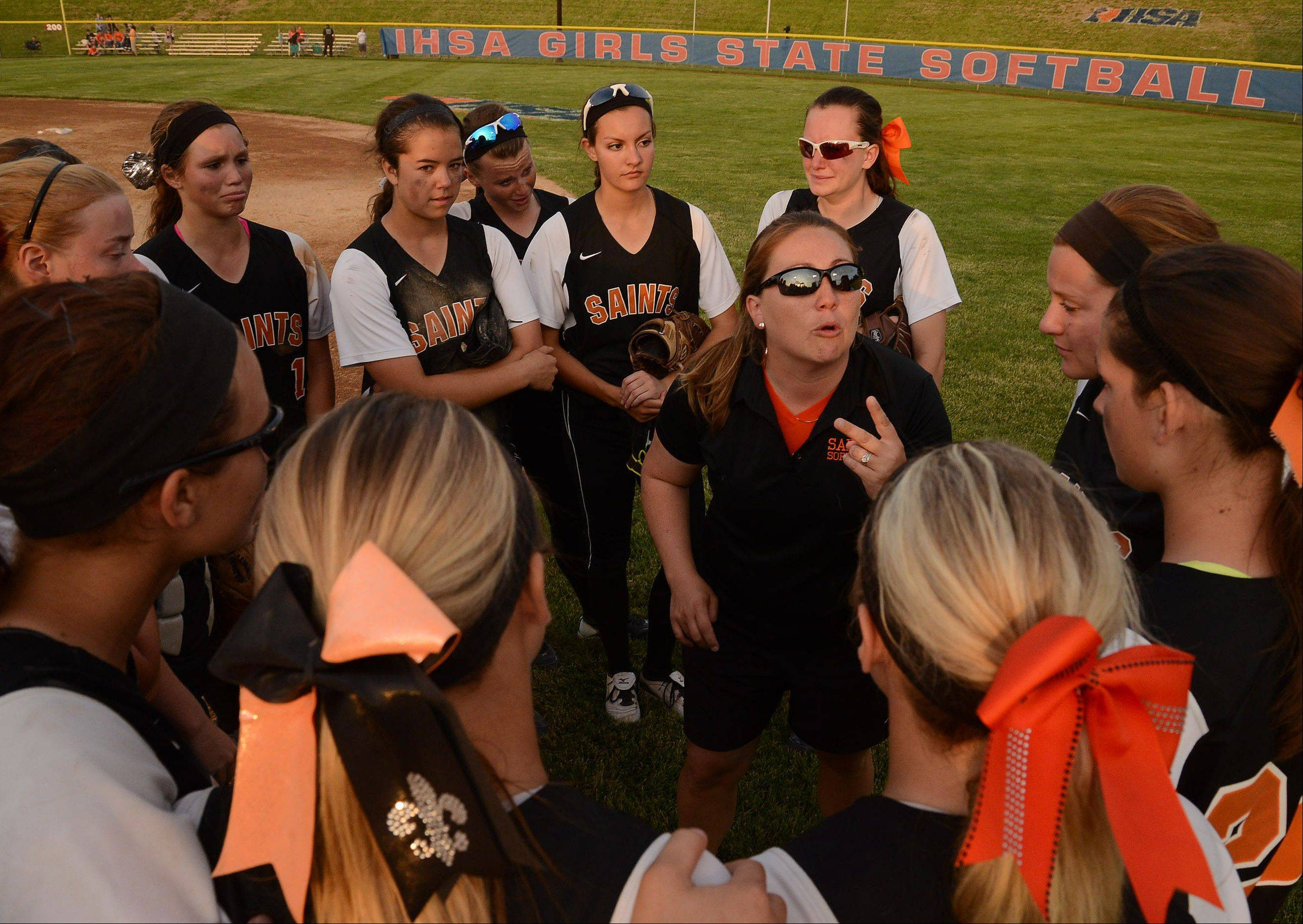 St. Charles East coach Kelly Hora congratulates her team for finishing 2nd to Minooka in the Class 4A softball championship game.