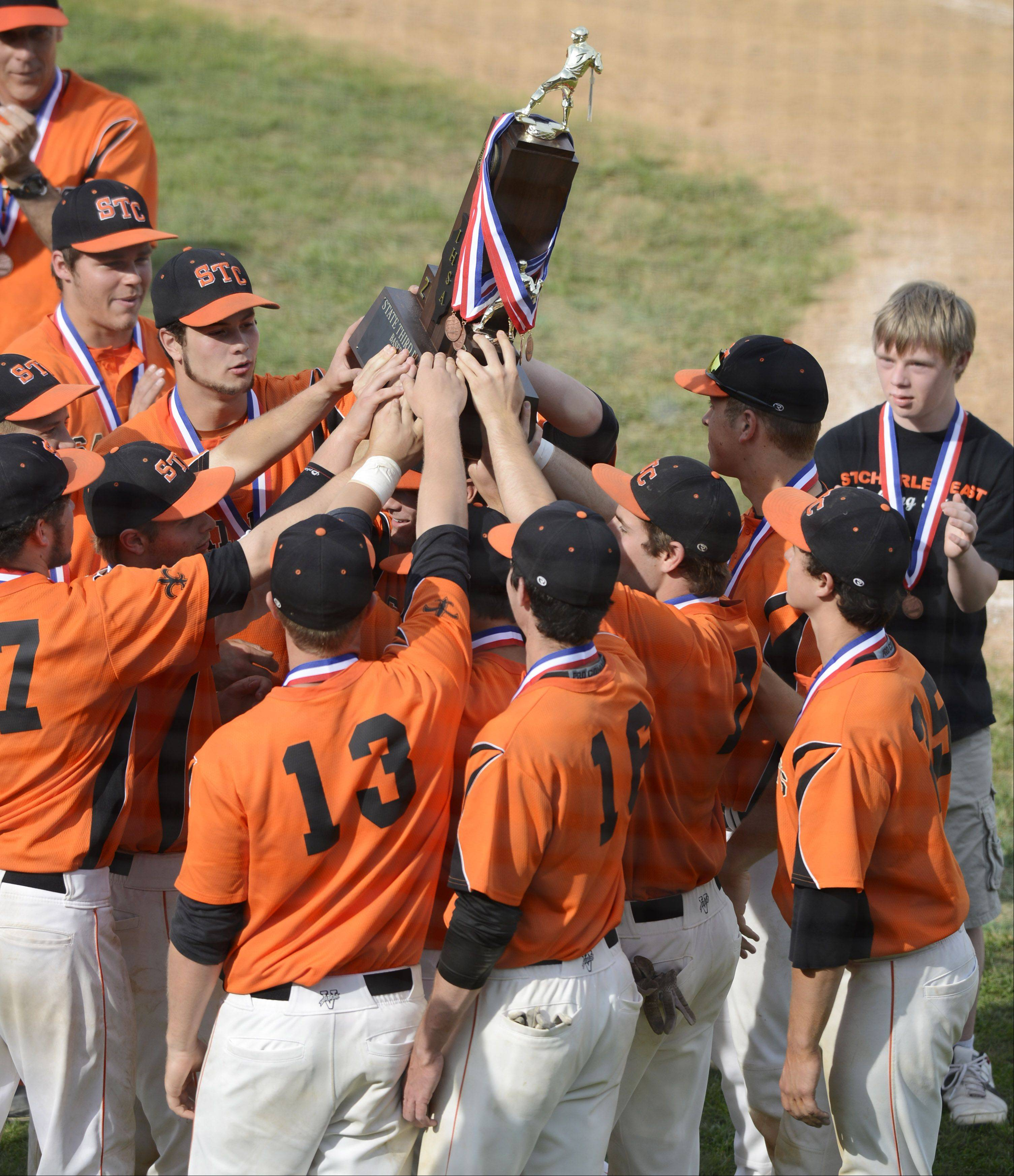 St. Charles East players hold up their third-place trophy following the Class 4A baseball third-place game against Neuqua Valley at Silver Cross Field in Joliet on Saturday.