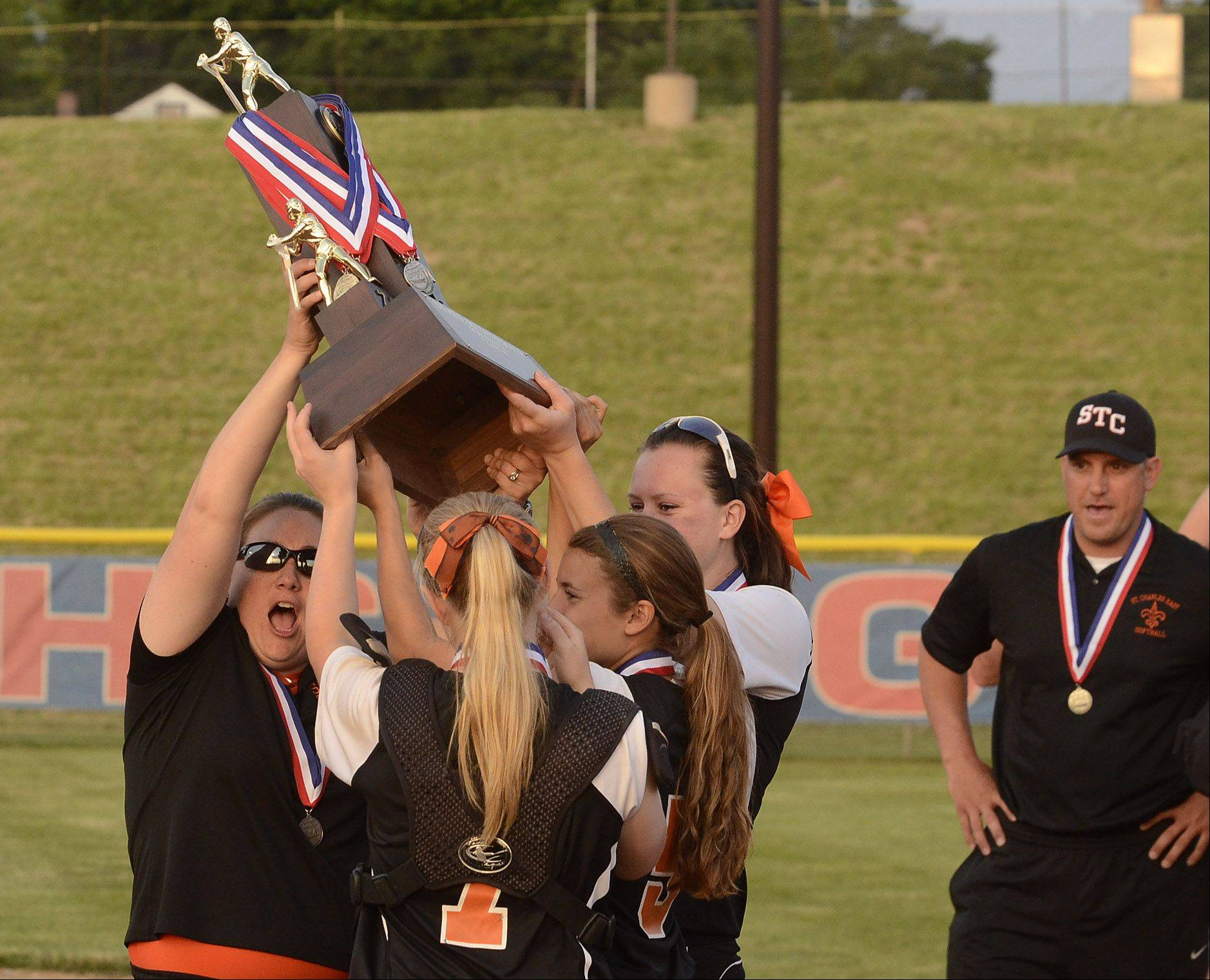 St. Charles East players hoist their 2nd place trophy after losing to Minooka in the Class 4A softball championship game.