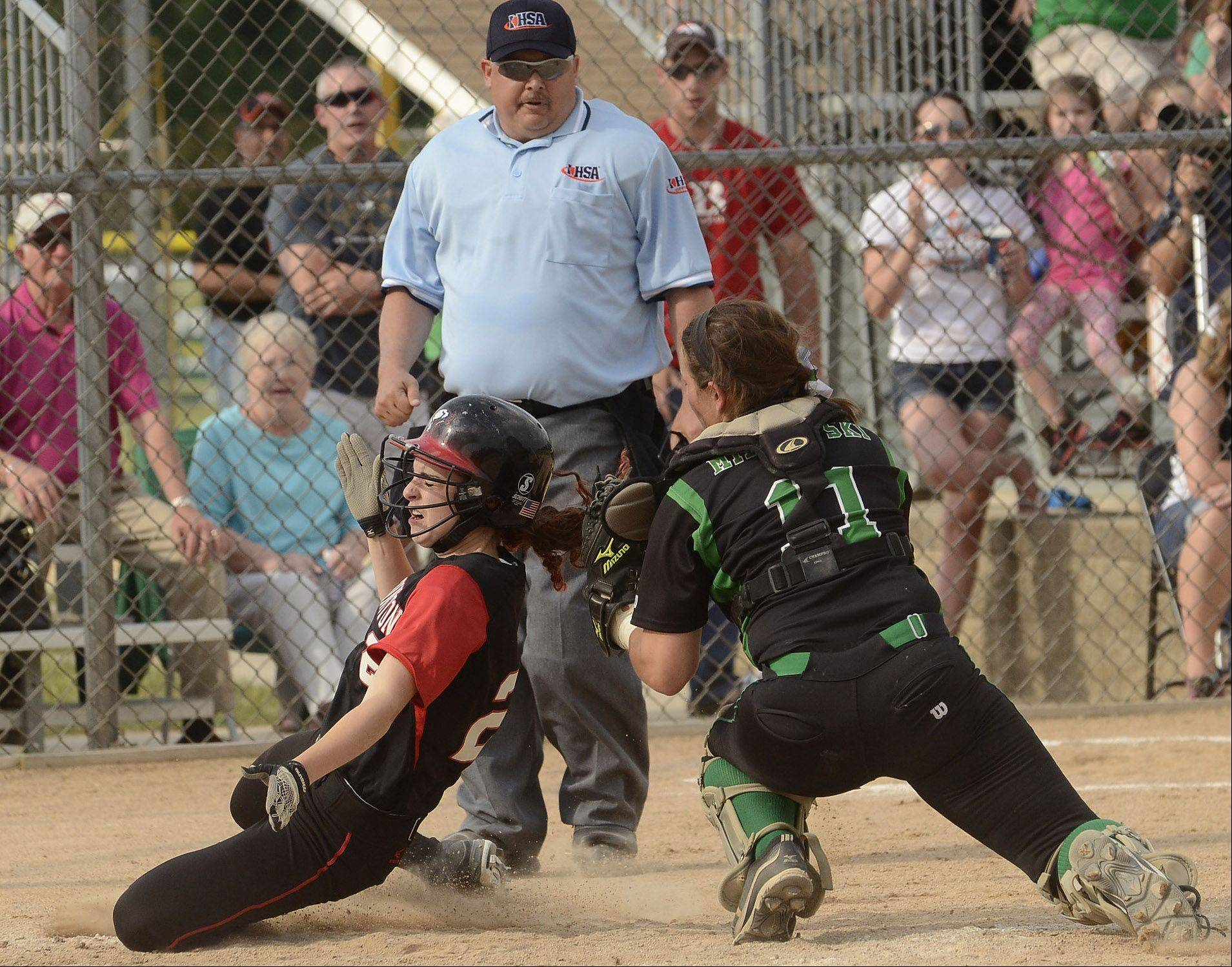 Barrington's Jenna Privatsky is tagged out at the plate by York catcher Sarah Milkowski in the top half of the 7th inning during Class 4A softball third place game between Barrington and York.