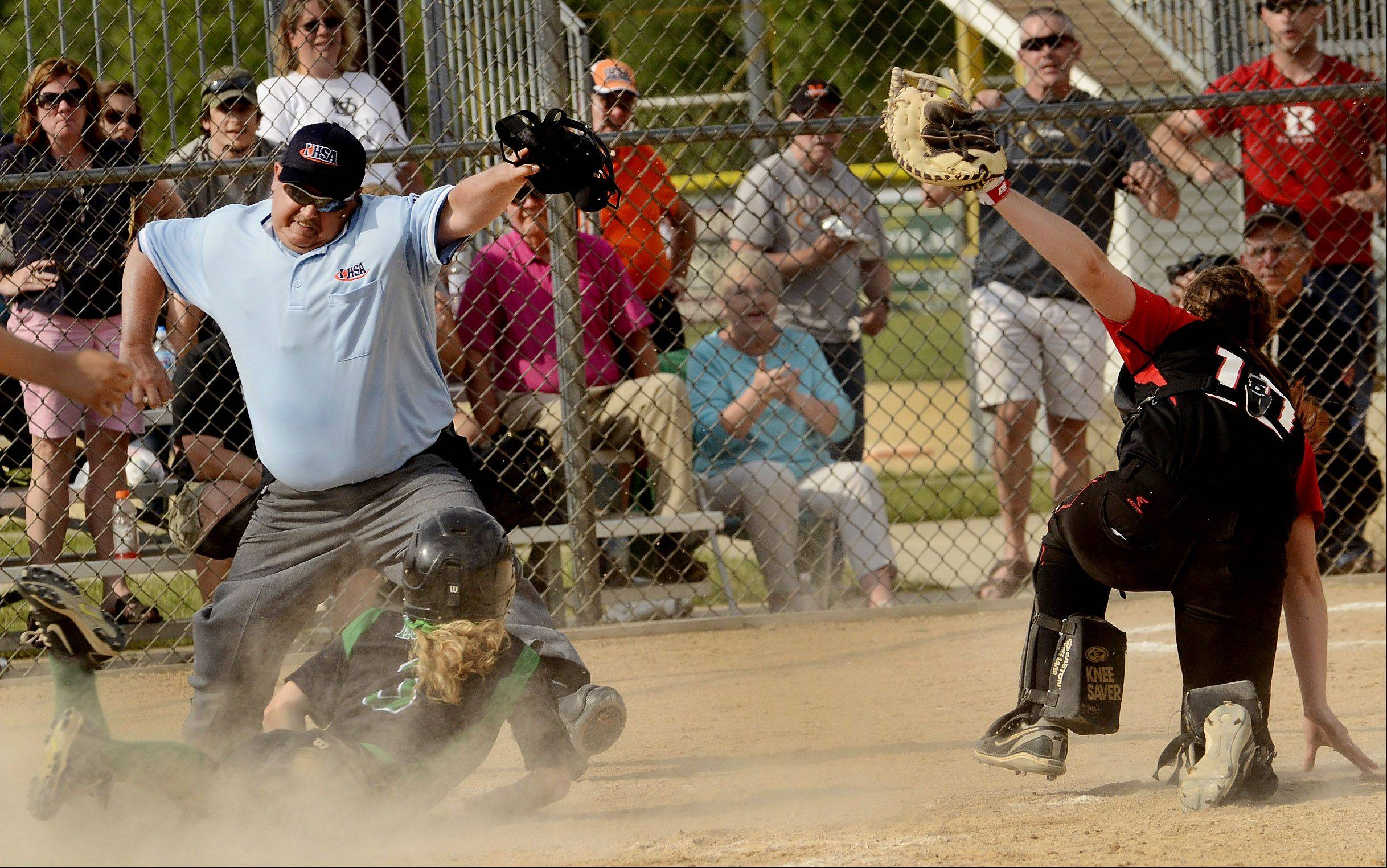 York's Kelly Mordini is tagged out at the plate by Barrington catcher Raegan Fingerman in the bottom of the 6th inning during Class 4A softball third place game between Barrington and York.