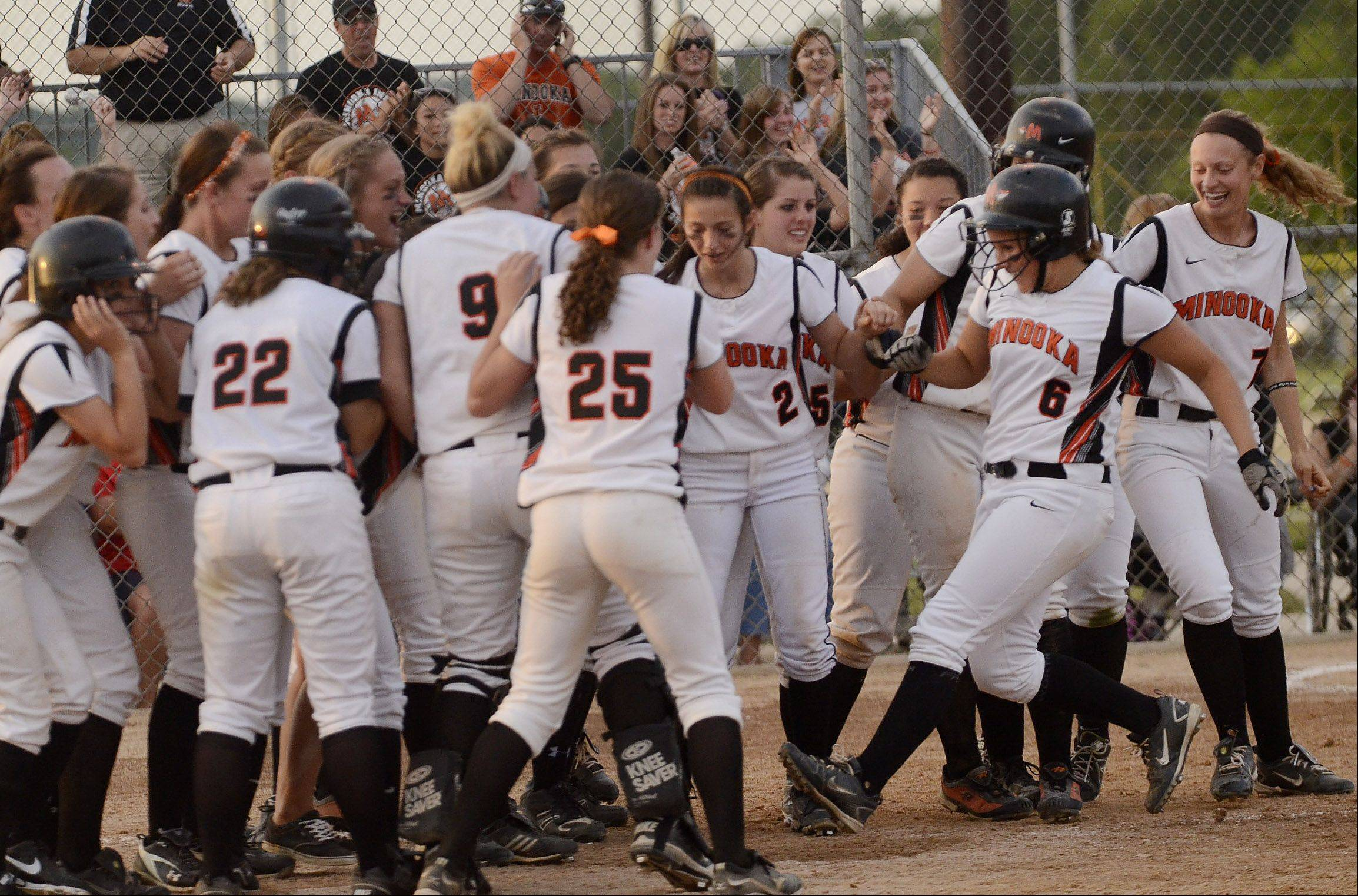 Minooka's Rachel May celebrates with teammates after hitting the game winning home run against St. Charles East in the Class 4A softball championship game.