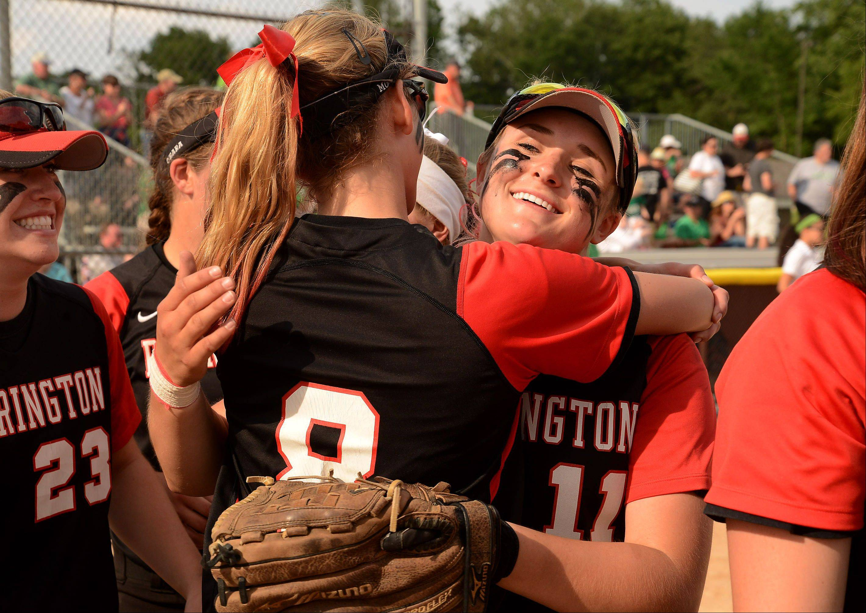 Barrington's Krista Moore, left, and Morgan Olszewski celebrate their Class 4A third place finish against York.