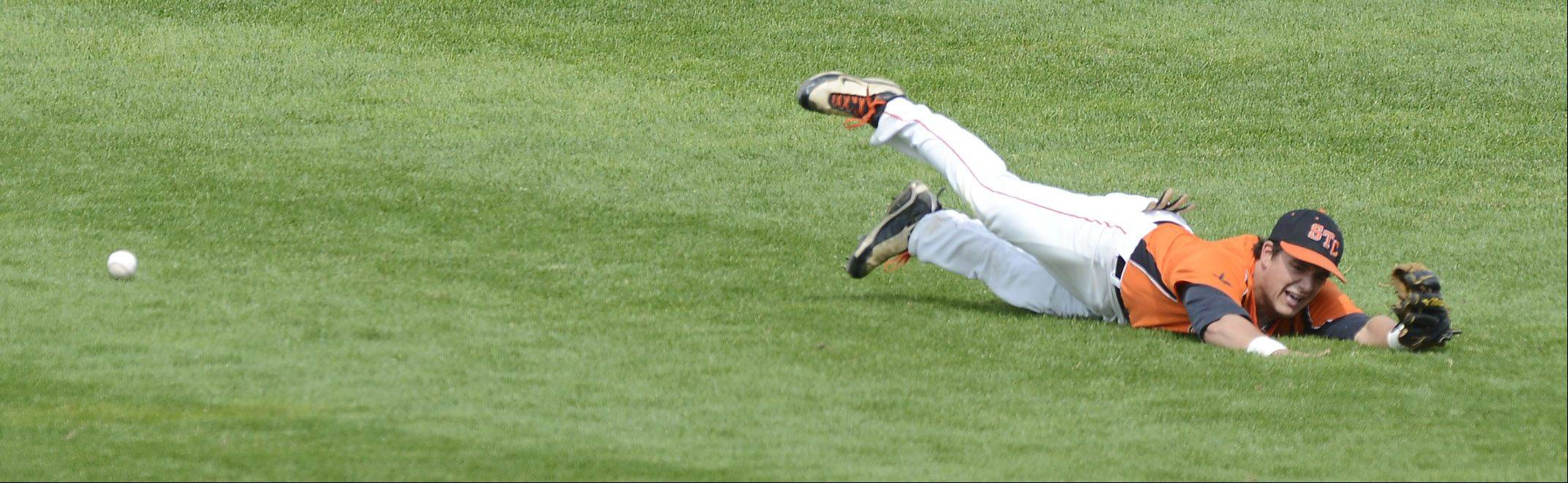St. Charles East center fielder Anthony Sciarrino can't quite get to a ball hit to the outfield by Neuqua Valley's Matt Butler in the second inning during the Class 4A state baseball third-place game at Silver Cross Field in Joliet Saturday.