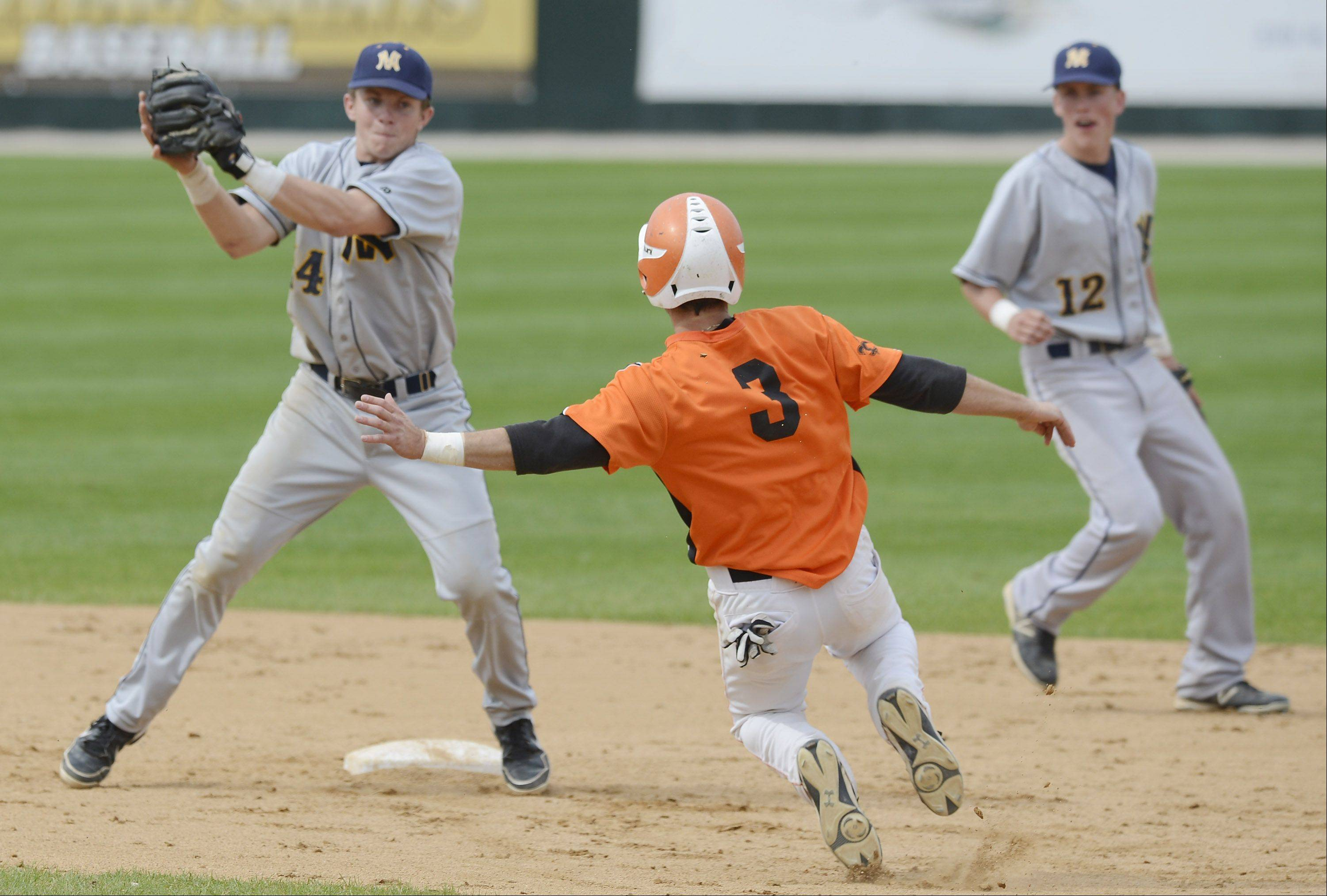 With shortstop Matt Wollnik backing up the play, Neuqua Valley shortstop gets ready to apply the tag on St. Charles East's Jack Dellostritto, who is called safe at second with a steal during the Class 4A state baseball third-place game at Silver Cross Field in Joliet Saturday.
