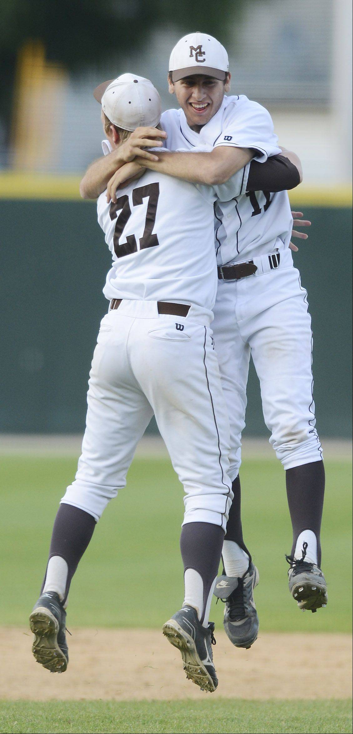Mt. Carmel pitcher Jeremy Kravetz, right, celebrates his team's victory over Libertyville with teammate Beau Filkins in the Class 4A state baseball championship game at Silver Cross Field in Joliet Saturday.